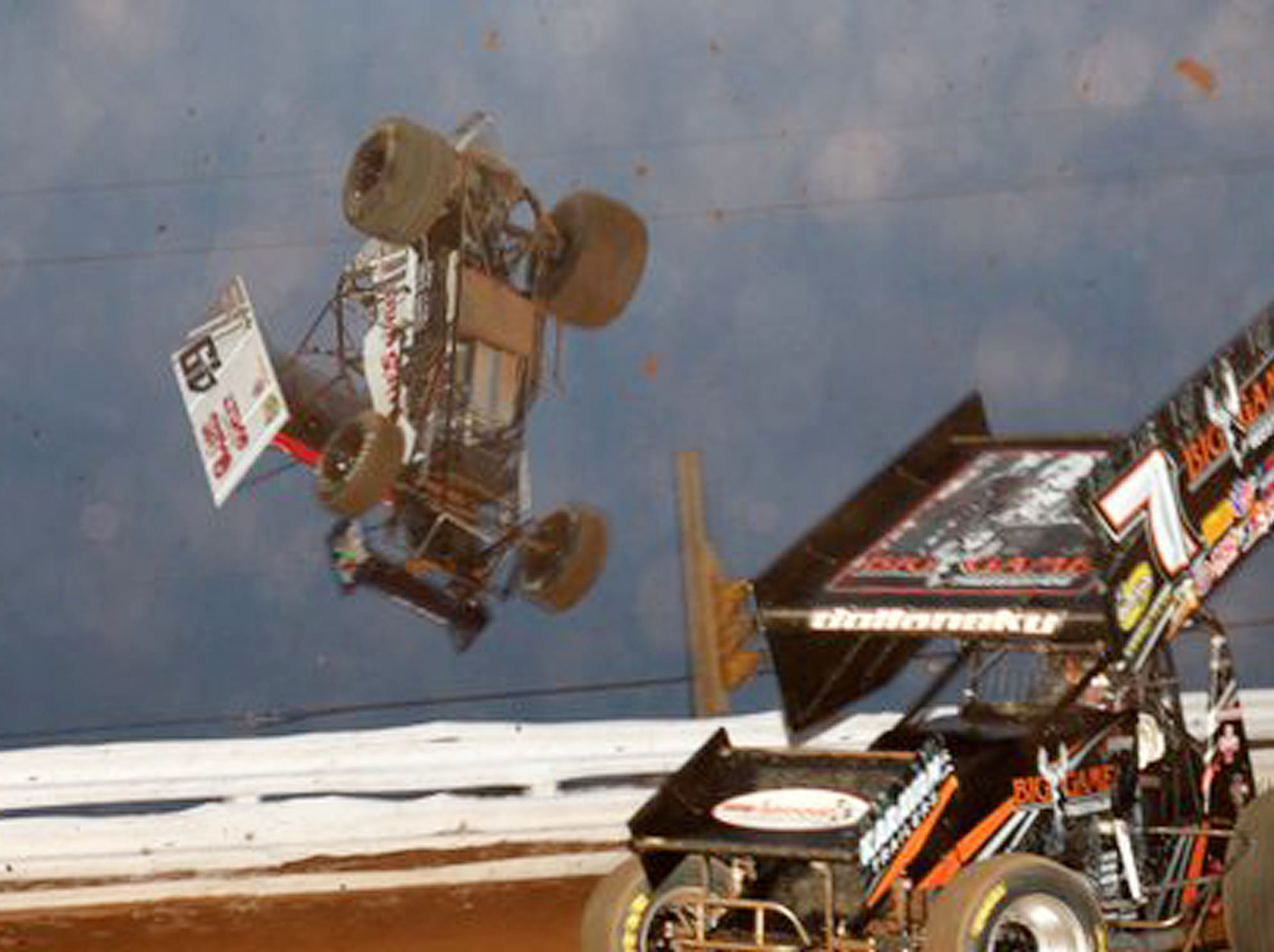 Kasey Kahne, in the No. 49 sprinter, after being nudged by the No. 7 car and   hitting the outside loose dirt, flips completely out and over the fencing of turn 4 at Williams Grove Speedway in 2011 without touching the outside fencing and landing upright on his four wheels during the heat races on Friday night. Kahne's car was smashed but he was not hurt.