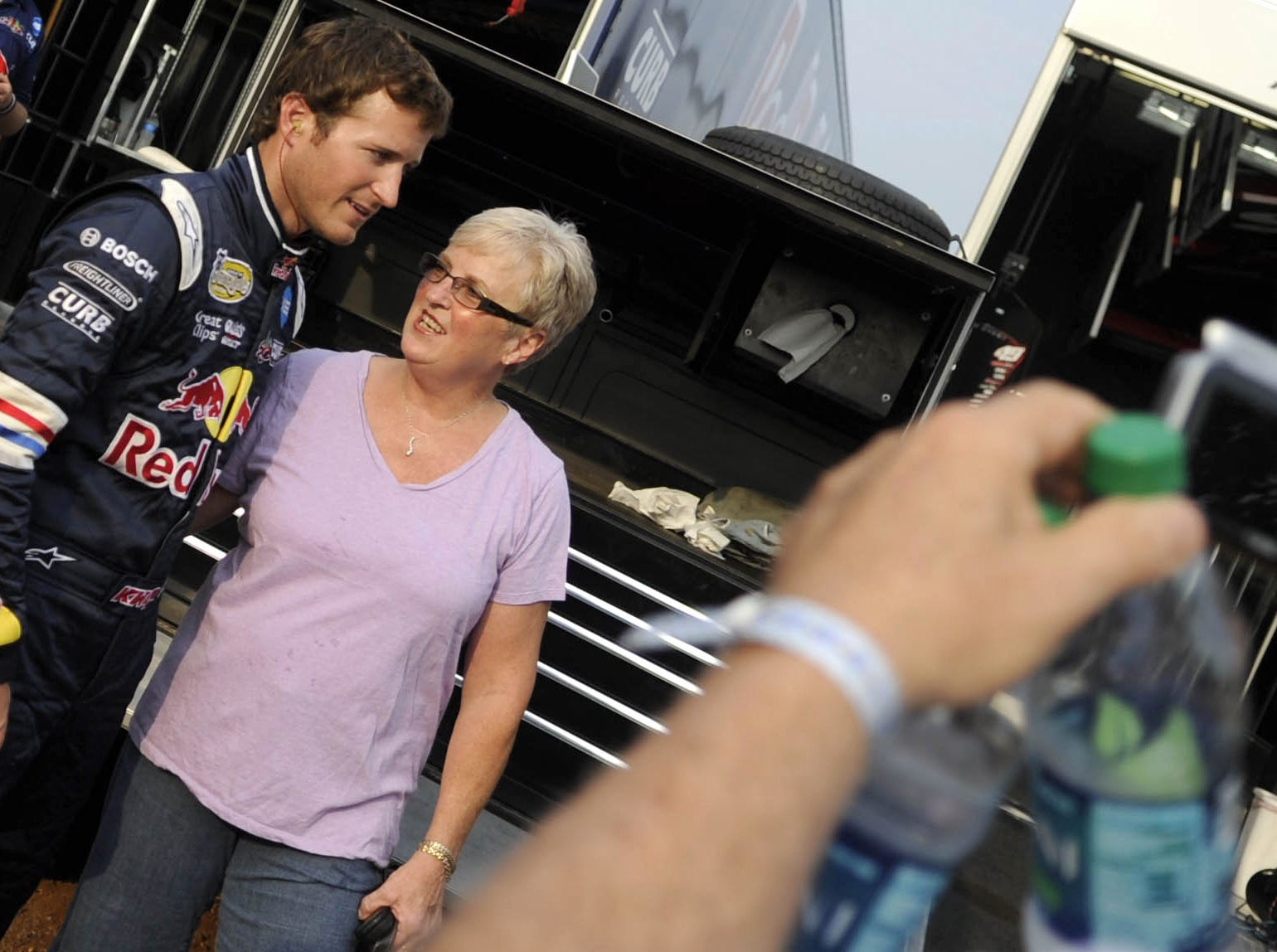 Margie Honeycutt of Salisbury has her photo taken with Kasey Kahne near the sprint car he would race at Williams Grove Speedway Friday, July 22, 2011.