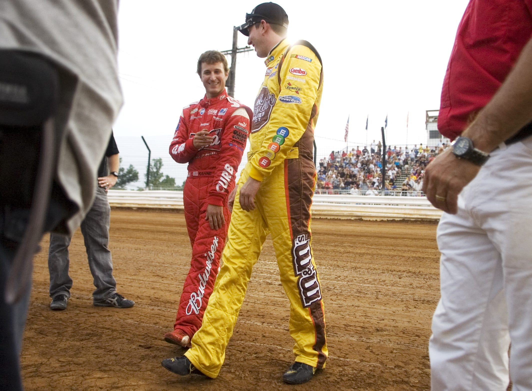 NASCAR drivers Kasey Kahne, left, and Kyle Busch walk across the track together at Williams Grove Speedway Wednesday, August 5, 2009.