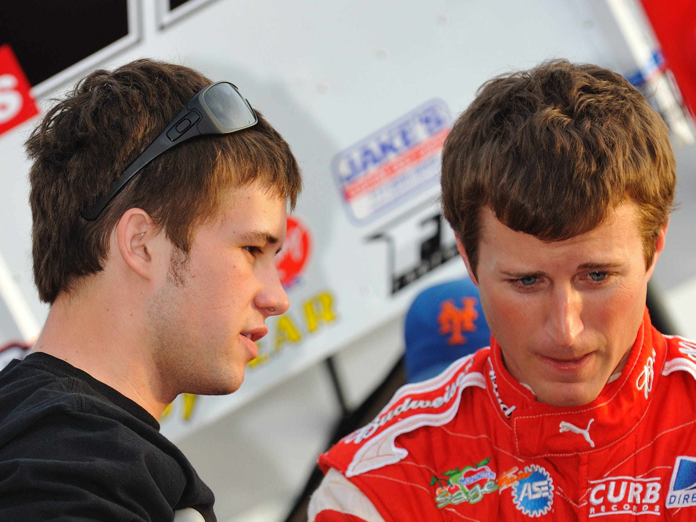 Red Lion's Cody Darrah (left) talks to car owner Kasey Kahne (right) before racing action at Williams Grove Speedway on April 2, 2010.
