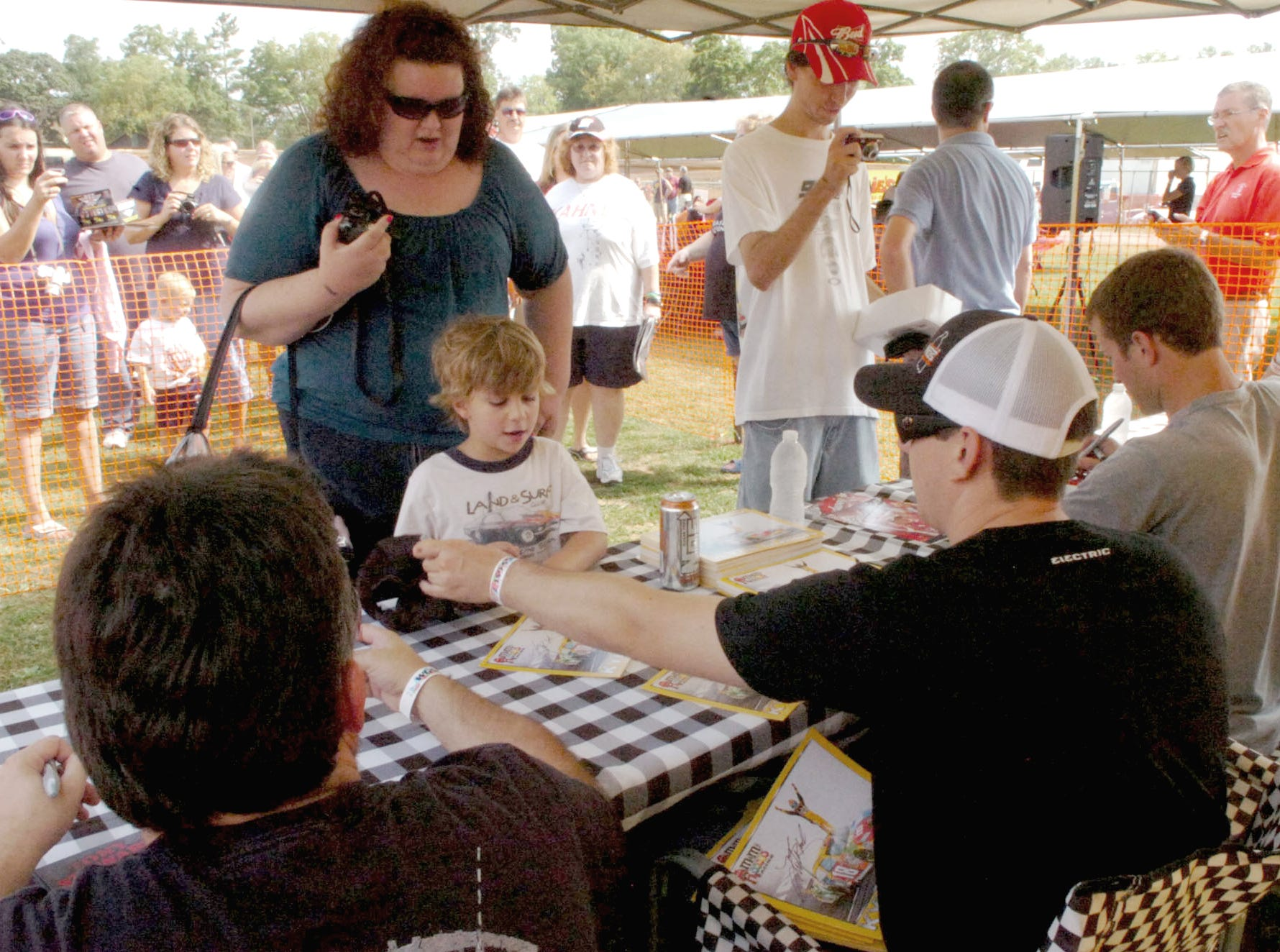 Fans stood in line in the sunny heat to get autographs of not only Kasey Kahne but Tony Stewart and Kyle Busch in 2010.