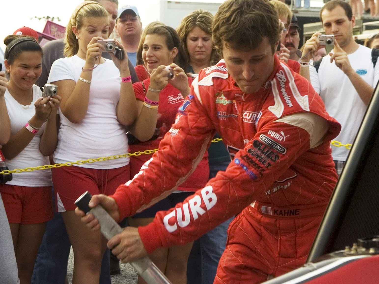 Young fans oggle NASCAR driver Kasey Kahne as he prepares his car to race at Williams Grove Speedway Wednesday, August 5, 2009.