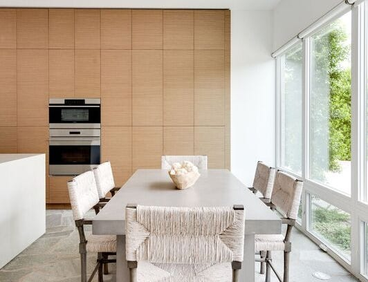Large windows fill the dining area with natural light.