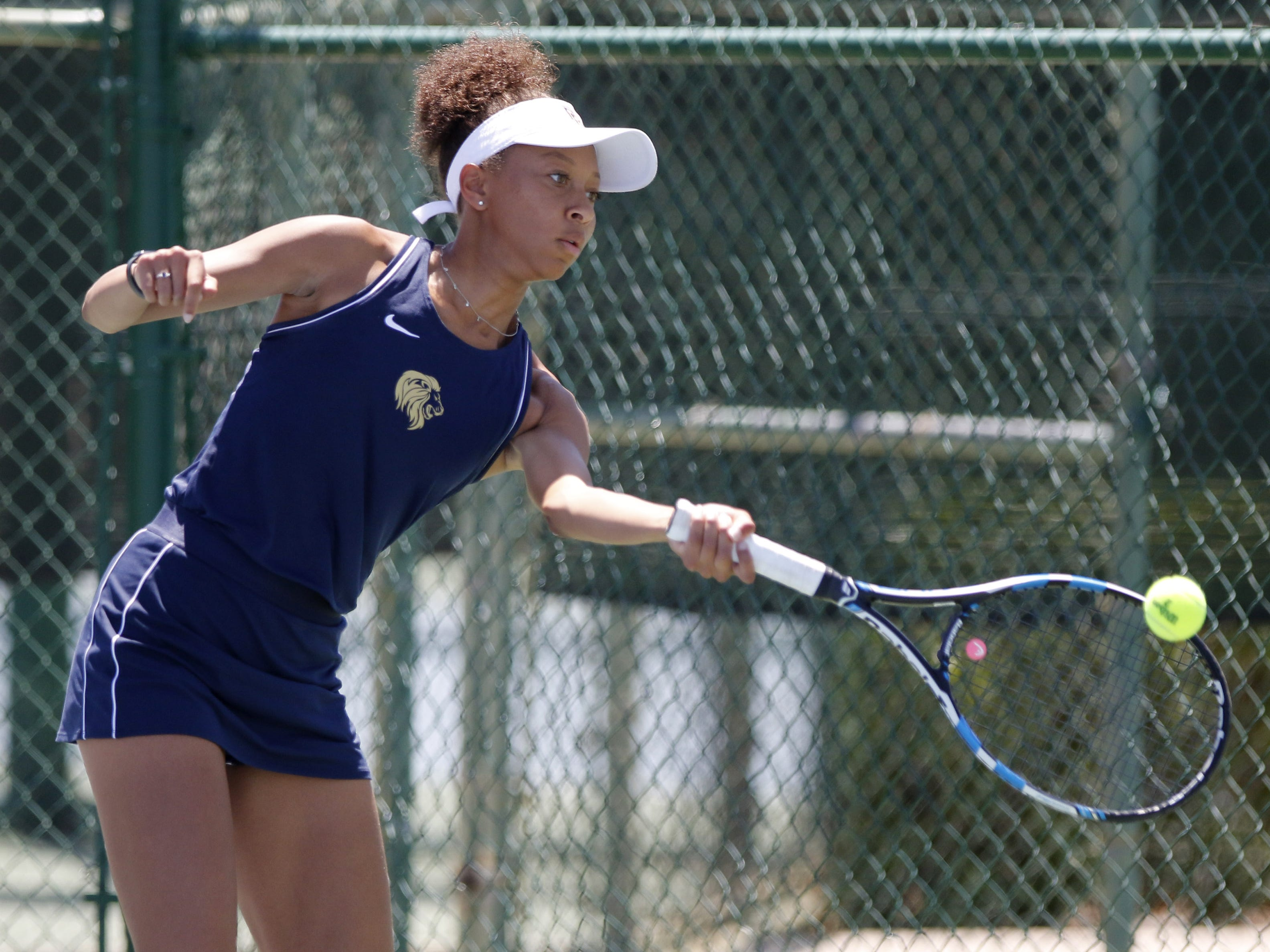 Pusch Ridge's Regan Harris returns a shot during her doubles match with Sofia Fetsis as they play against Thatcher during the Division III tennis team state championship in Glendale, Arizona, May 04, 2019.