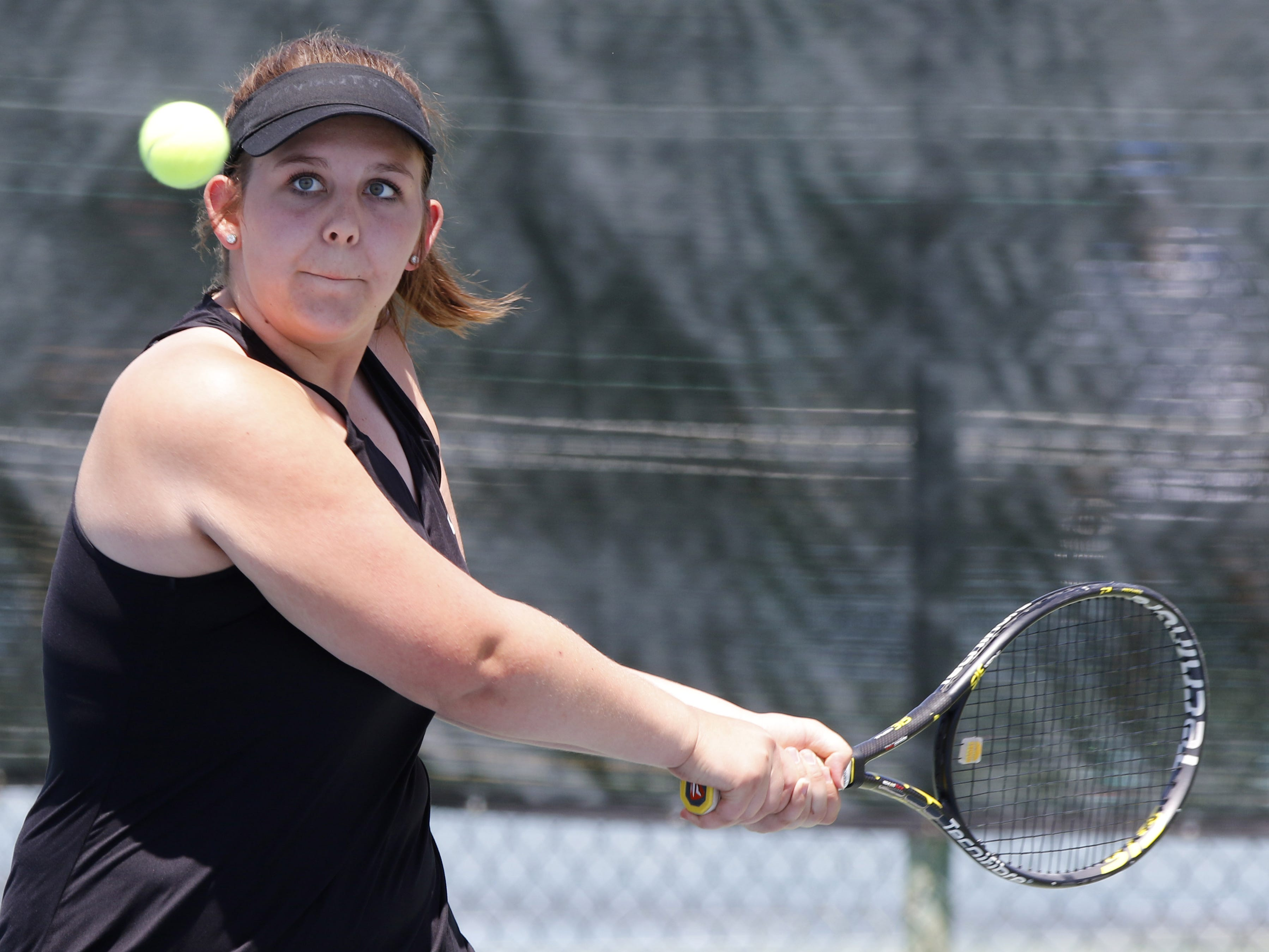 Thatcher's Savanna Turley eyes the ball as she plays Pusch Ridge's Colleen Harris during the Division III tennis team state championship in Glendale, Arizona, May 04, 2019.
