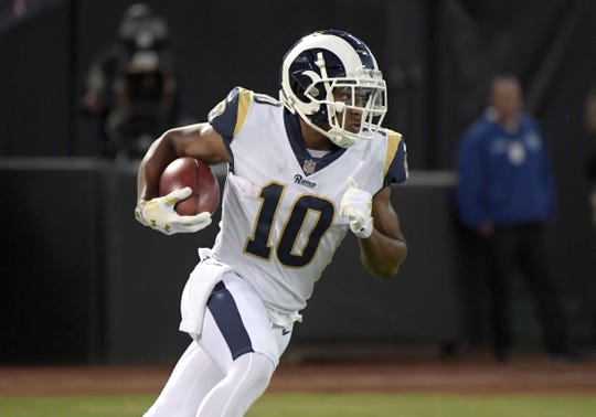 Former Rams receiver Pharoh Cooper  runs with the ball during a game against the Raiders at the Oakland-Alameda County Coliseum.