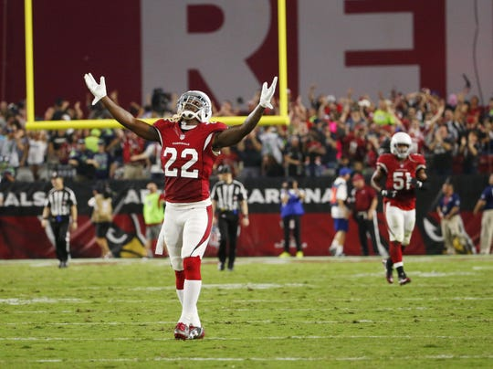 Cardinals strong safety Tony Jefferson raises his arms after the Seahawks missed a game-winning field goal in overtime in 2016. This was that game that ended in a tie!