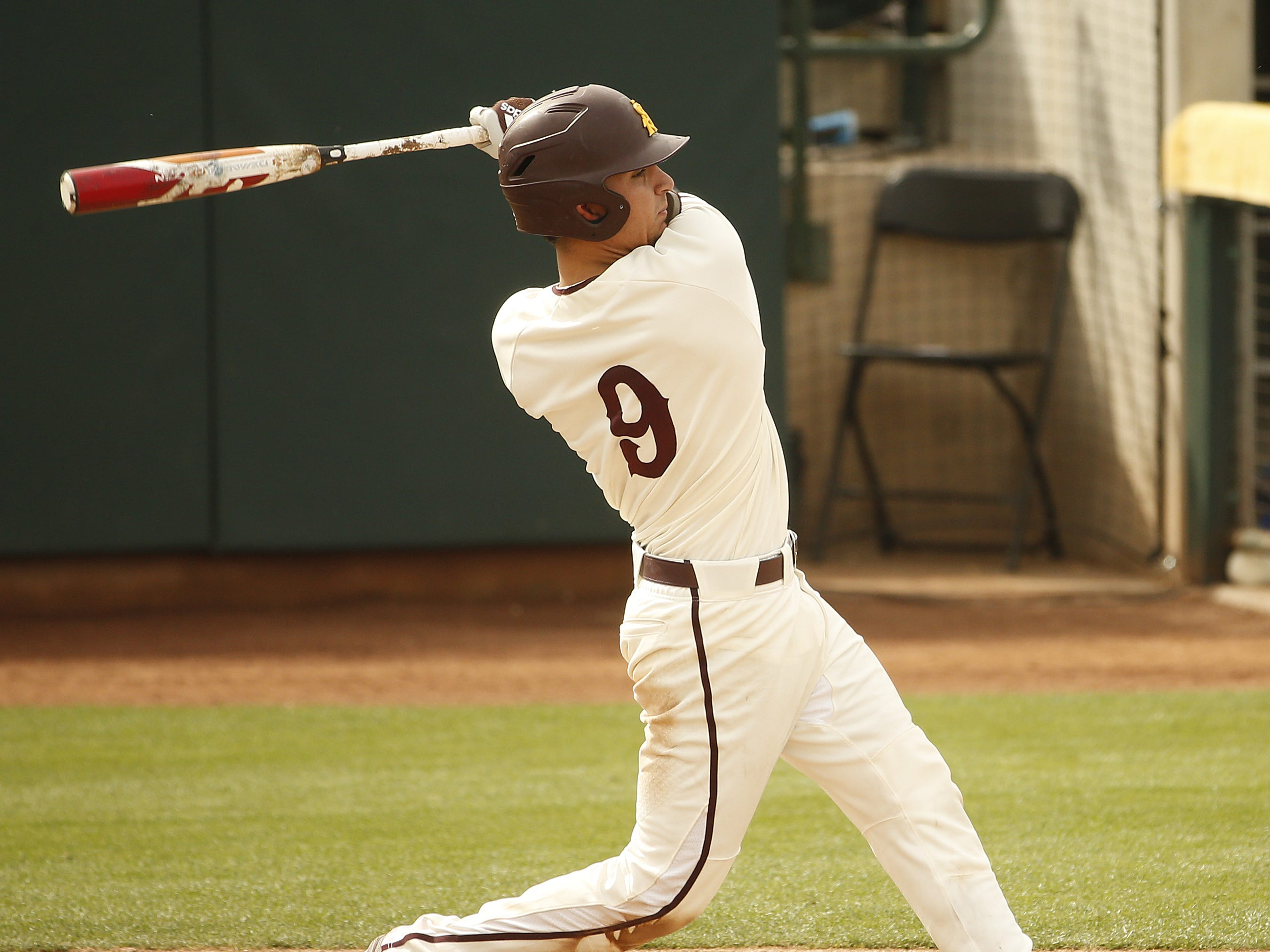 ASU's Sam Ferri (9) hits a fly out against UCLA at Phoenix Municipal Stadium in Phoenix, Ariz. on May 5, 2019.
