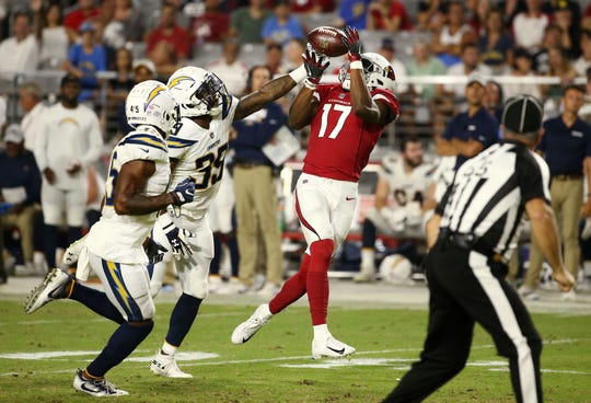 Cardinals receiver Jalen Tolliver makes a catch against the Chargers during a preseason game at University of Phoenix Stadium.