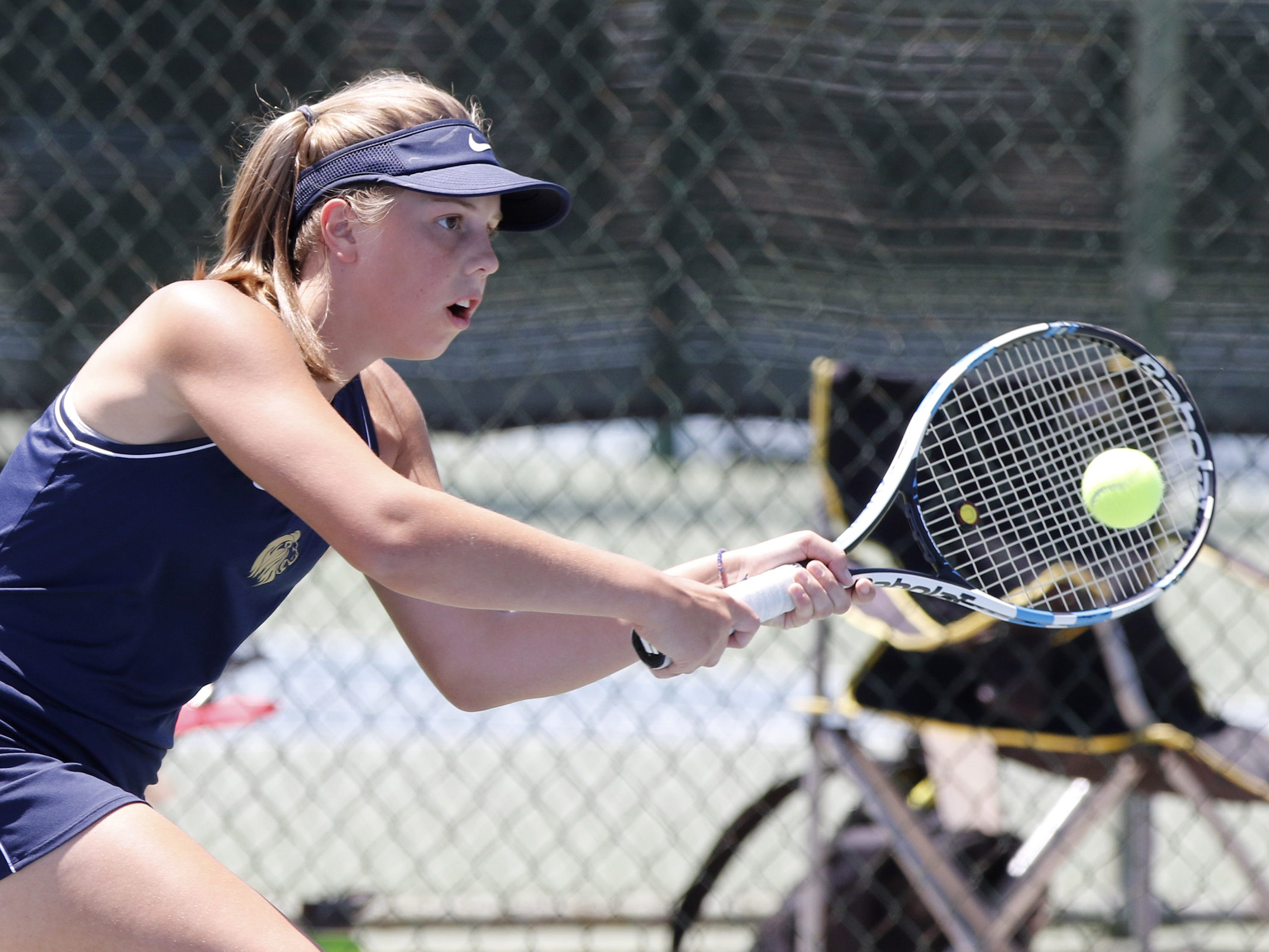 Pusch Ridge's Colleen Harris eyes the ball as she plays Thatcher's Savanna Turley during the Division III tennis team state championship in Glendale, Arizona, May 04, 2019.