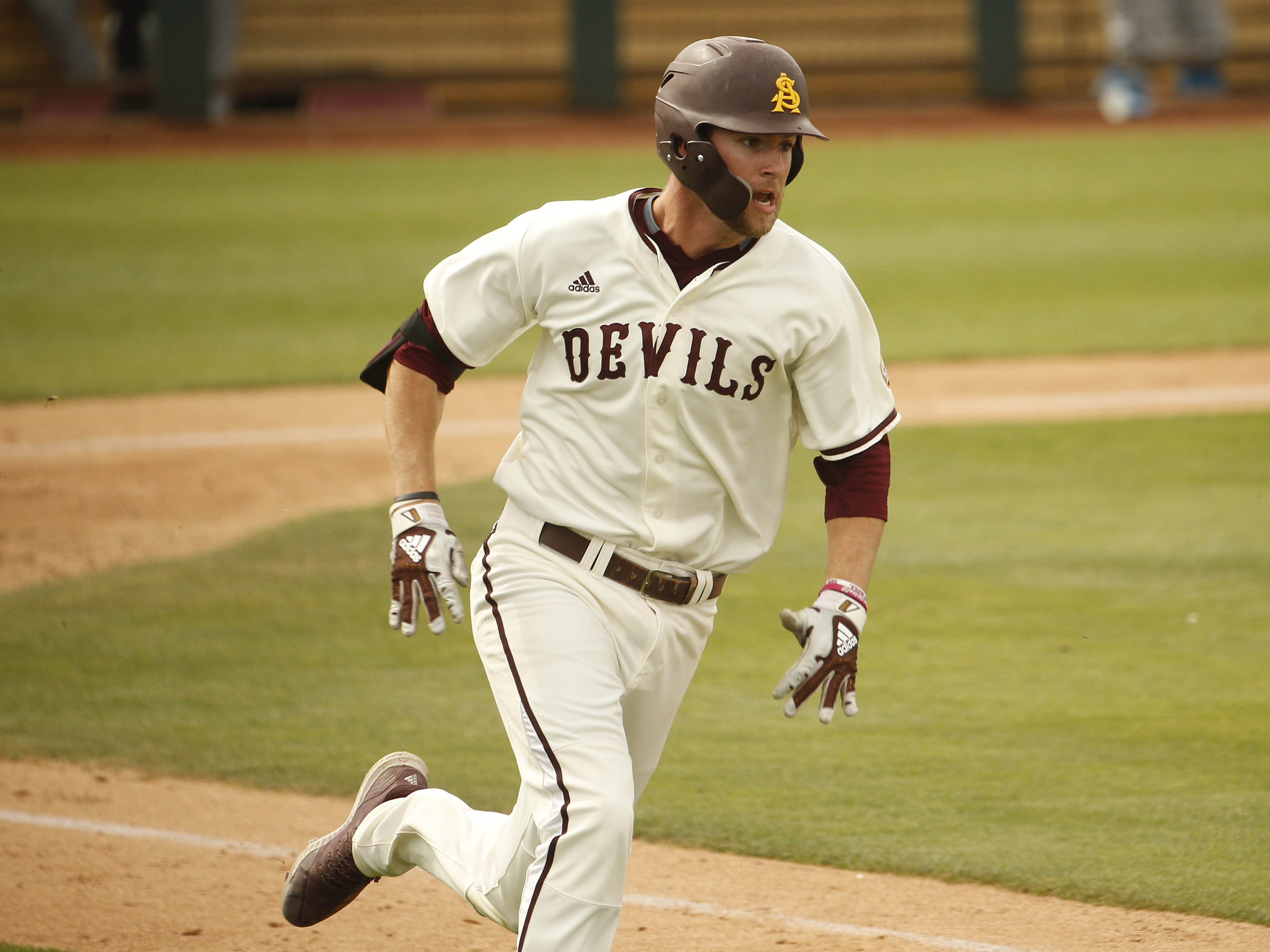 ASU's Gage Workman (14) heads to first on his way to a double during the fifth inning against UCLA at Phoenix Municipal Stadium in Phoenix, Ariz. on May 5, 2019.
