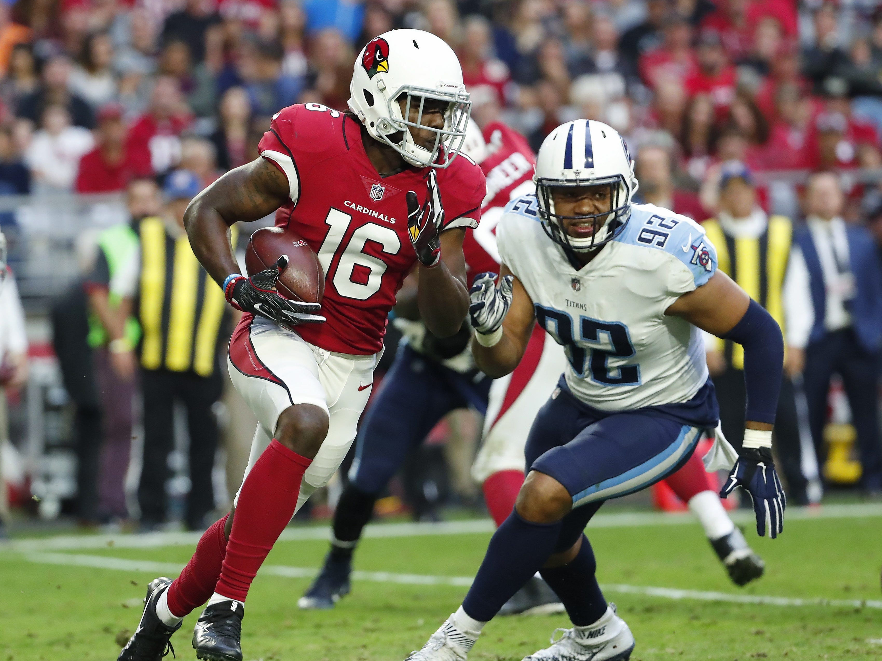 Cardinals receiver Chad Williams runs with the ball past Titans linebacker Kevin Dodd during a game against Tennessee on Dec. 10, 2017 at University of Phoenix Stadium.