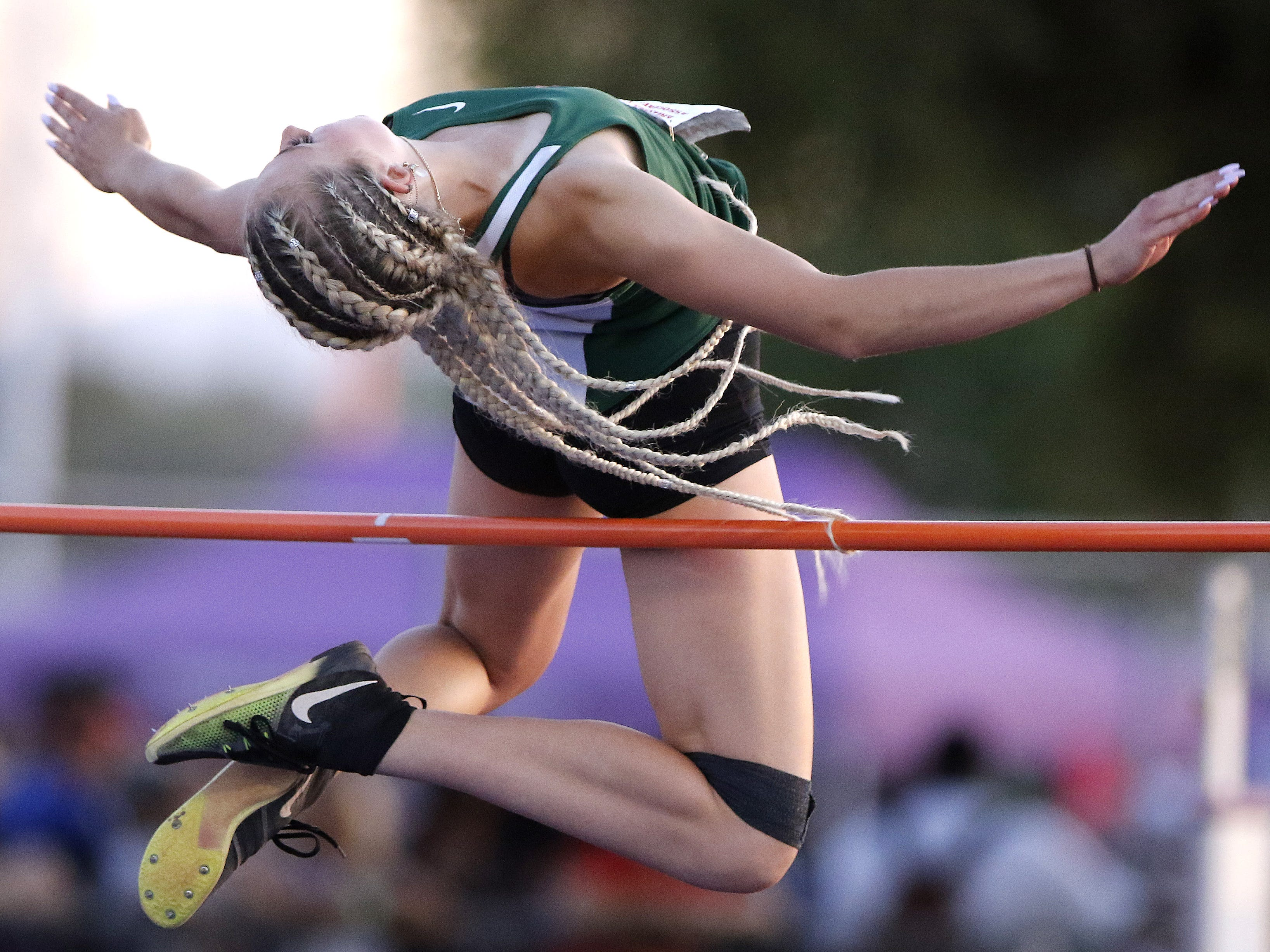 Campo Verde's Naomi Greene's hair wraps around the bar as she competes in the Division II high jump championship during the 2019 Arizona State Track and Field Championship at Mesa Community College in Mesa, Arizona, May 04, 2019.
