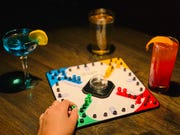 Trouble is one of the classic board games offered at Linger Longer Lounge.