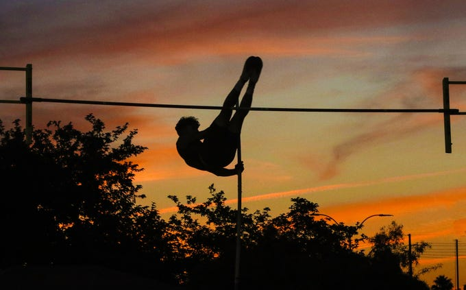 A pole vaulter makes his way over the bar during the 2019 Arizona State Track and Field Championship at Mesa Community College in Mesa, Arizona, May 04, 2019.