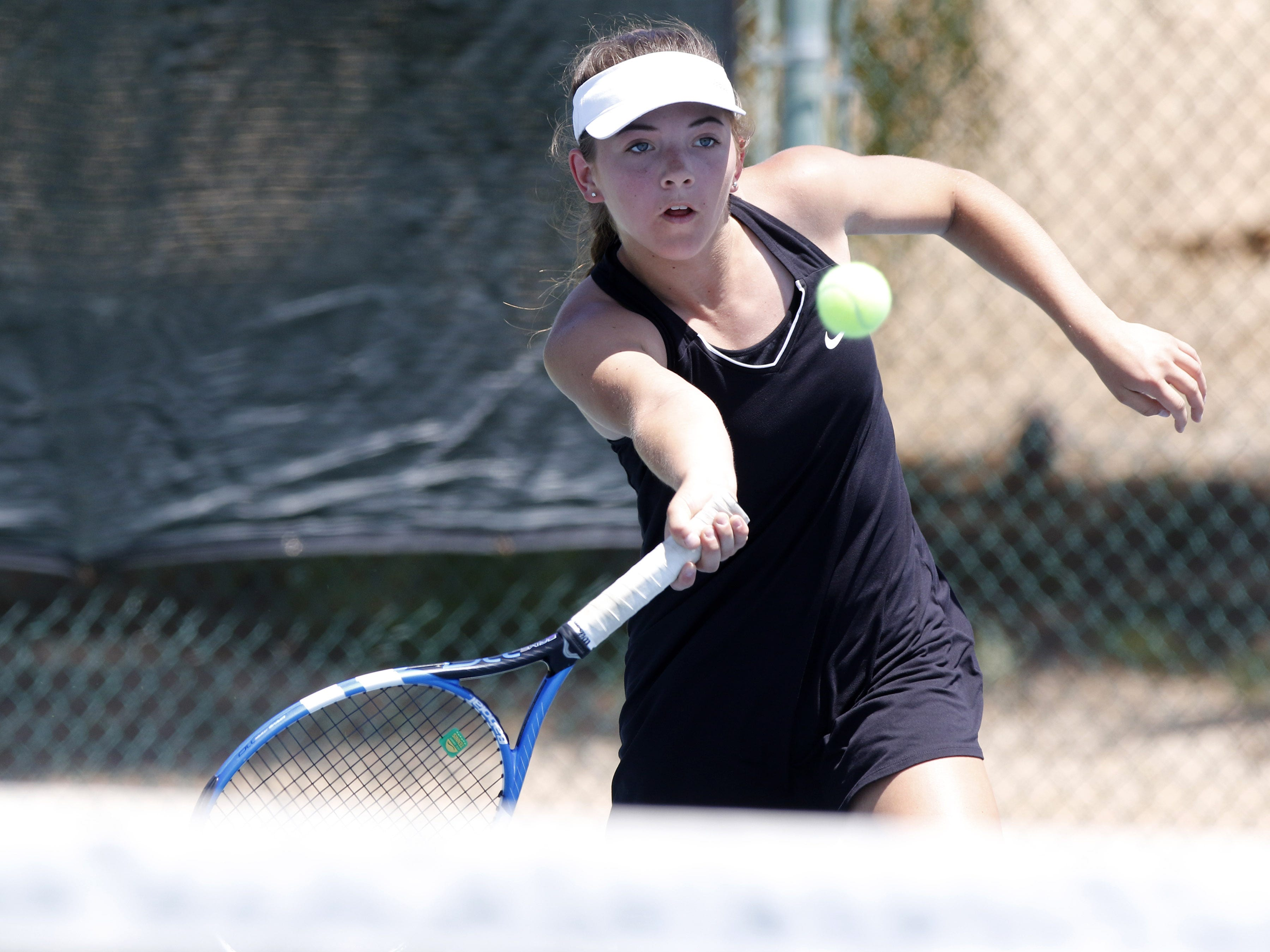Thatcher's Ellie Akler returns a forehand shot as she plays Pusch Ridge's Emily Johnsboen during the Division III tennis team state championship in Glendale, Arizona, May 04, 2019.