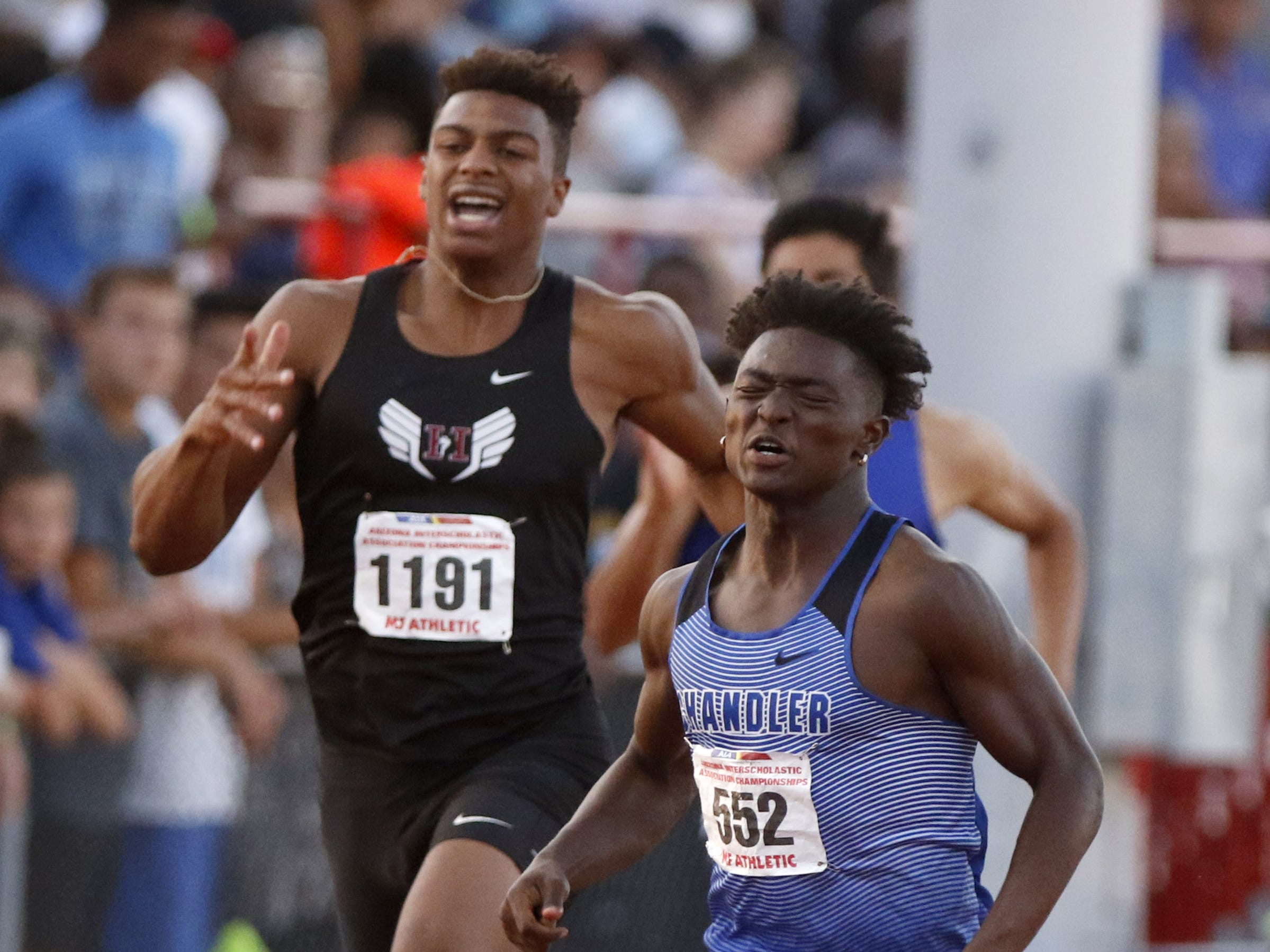 Chandler's Quaron Adams finishes second ahead of Hamilton's Brenden Rice in the Division I 200 meters championship during the 2019 Arizona State Track and Field Championship at Mesa Community College in Mesa, Arizona, May 04, 2019.