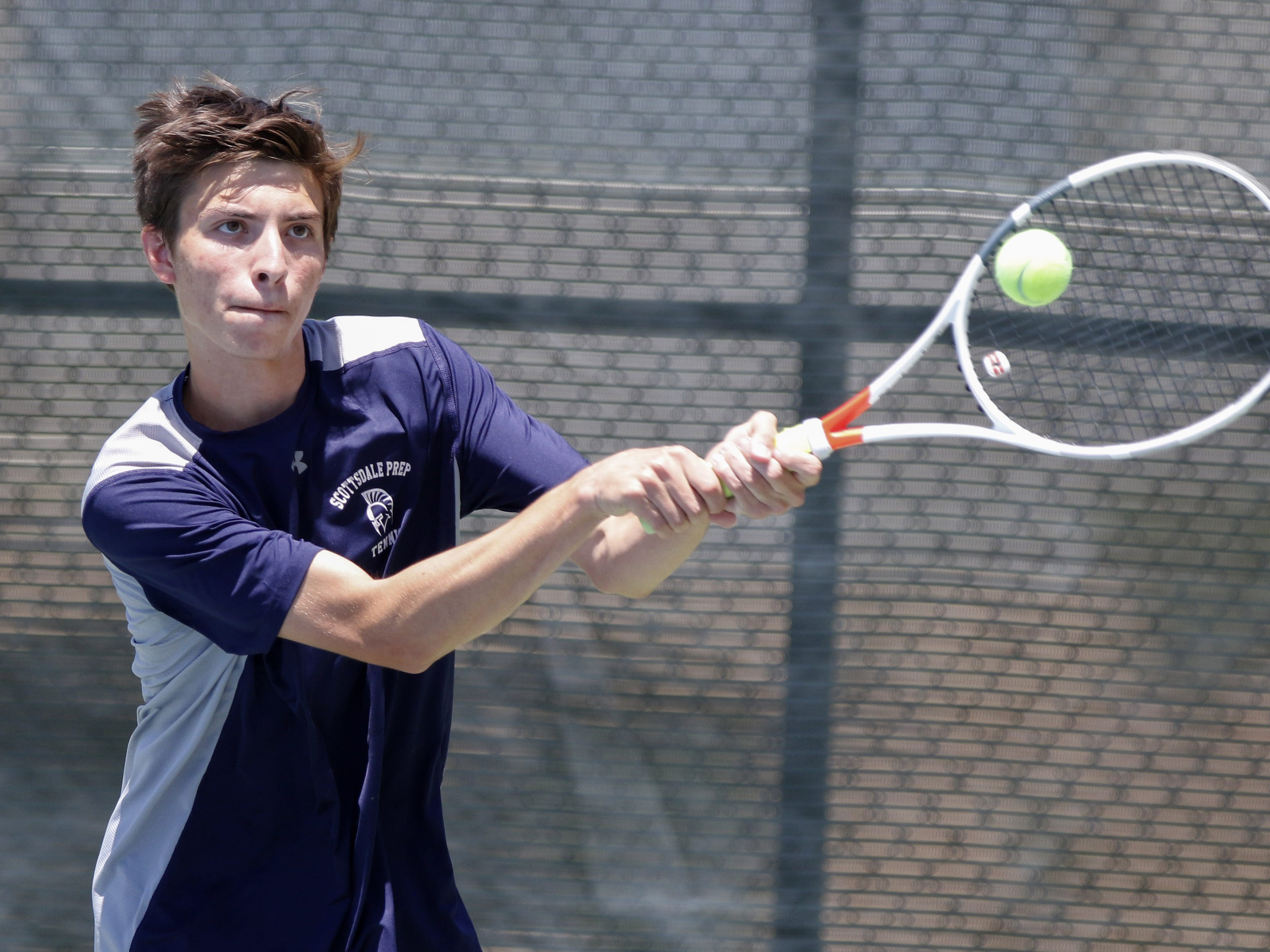 Scottsdale Prep's Aidan Bossone eyes the ball as he plays Phoenix Country Day's Alex Tam during the Division III tennis team state championship in Glendale, Arizona, May 04, 2019.