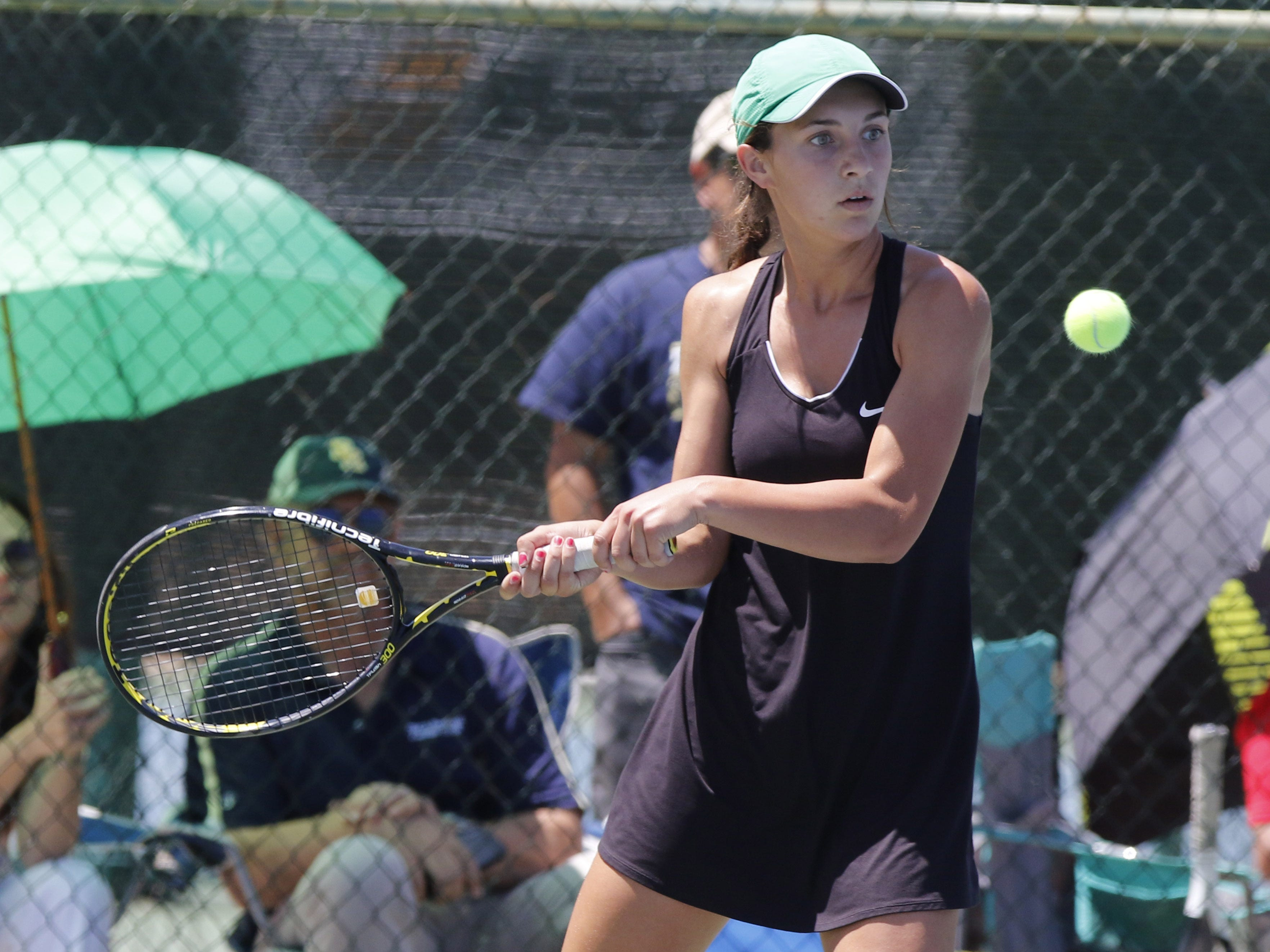 Thatcher's Ashlyn McMaster works her backhand as she plays Pusch Ridge's Emma Reily during the Division III tennis team state championship in Glendale, Arizona, May 04, 2019.