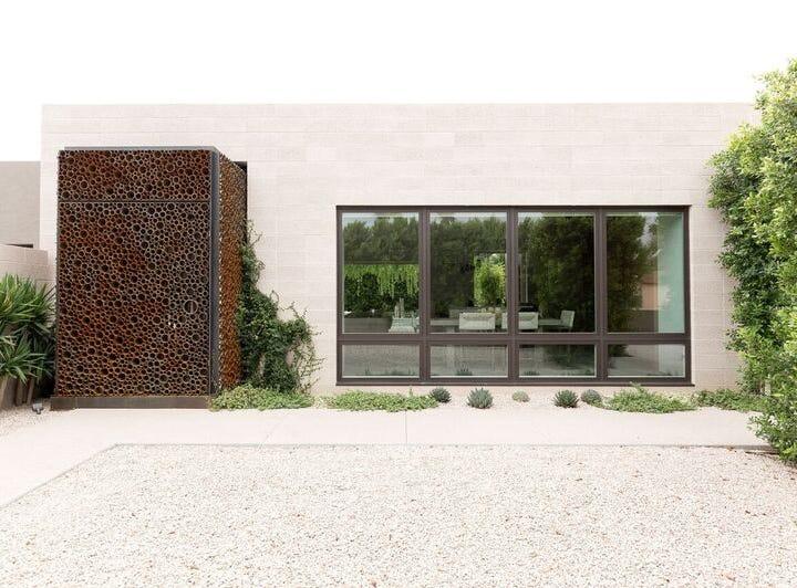 The front door is a piece of art. Cody Carpenter of Studio Make created the unique steel pipe door.