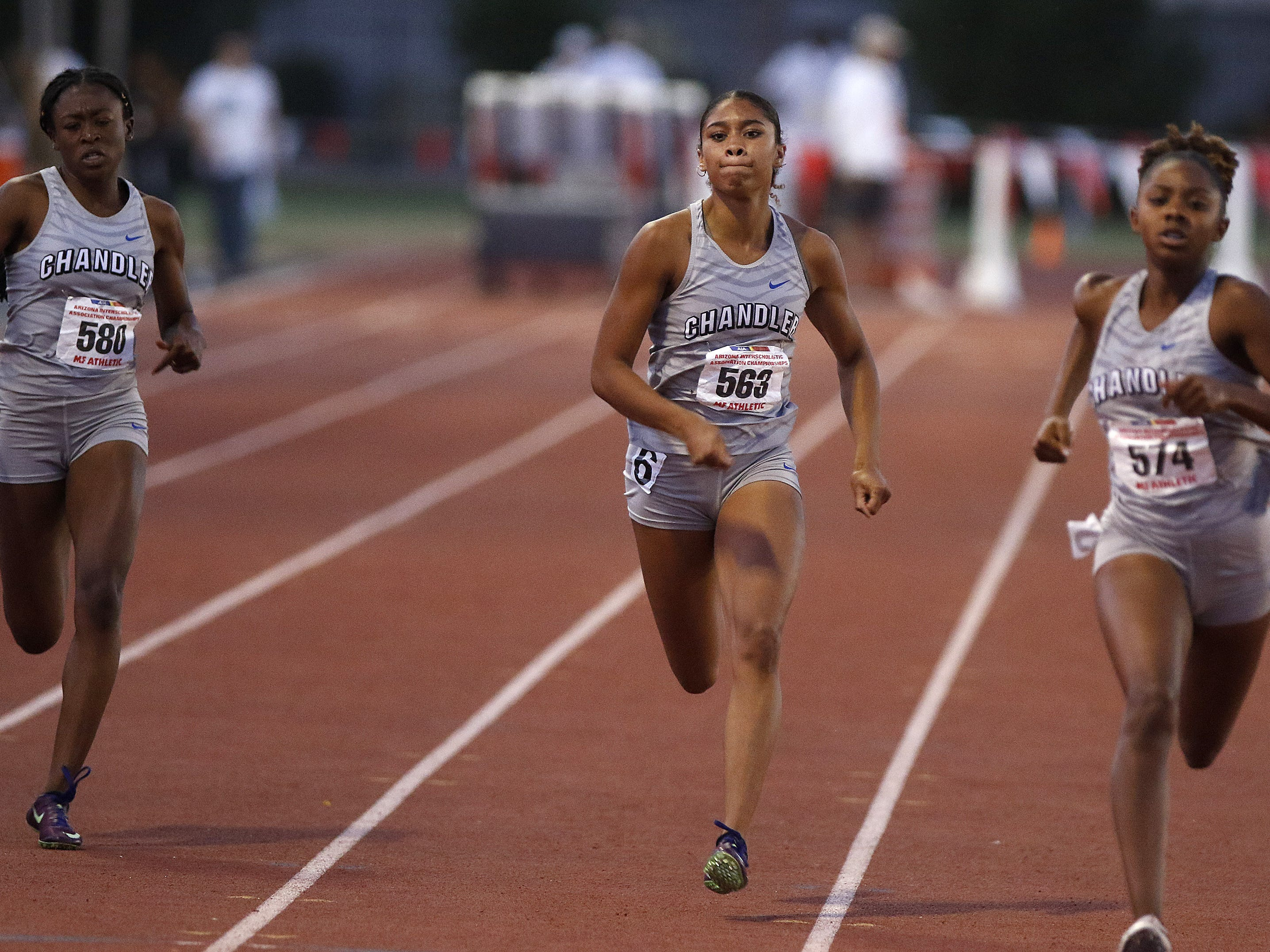 Chandler's Trinity Henderson(left) finishes 4th while teammate Jocelyn Johnson (middle) finishes 2nd behind first place finisher Kelise Davis (right) during the 400 meter run during the 2019 Arizona State Track and Field Championship at Mesa Community College in Mesa, Arizona, May 04, 2019.