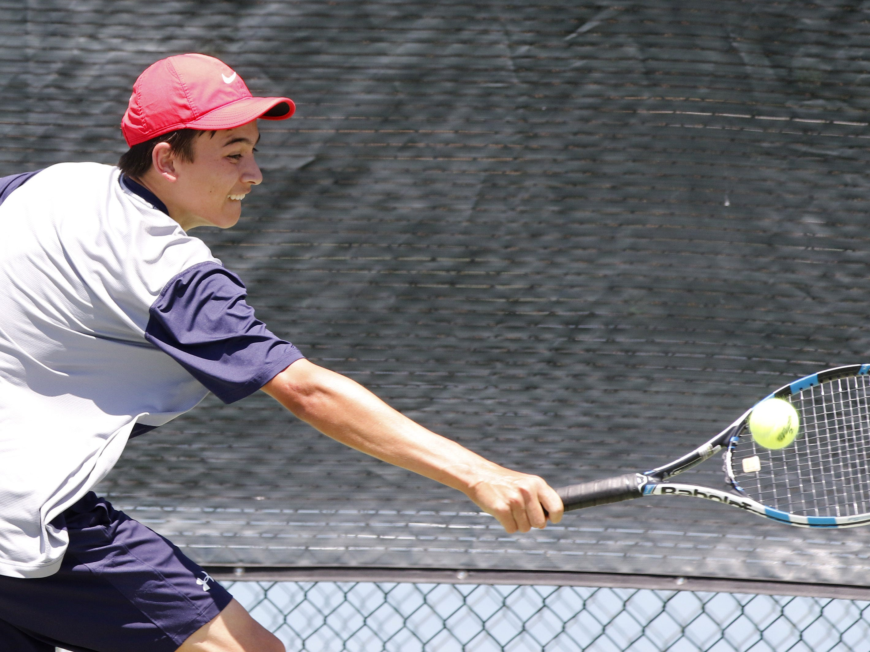 Scottsdale Prep's Jack Swensen backhands a shot against Phoenix Country Day's Ashton Kroger during the Division III tennis team state championship in Glendale, Arizona, May 04, 2019.