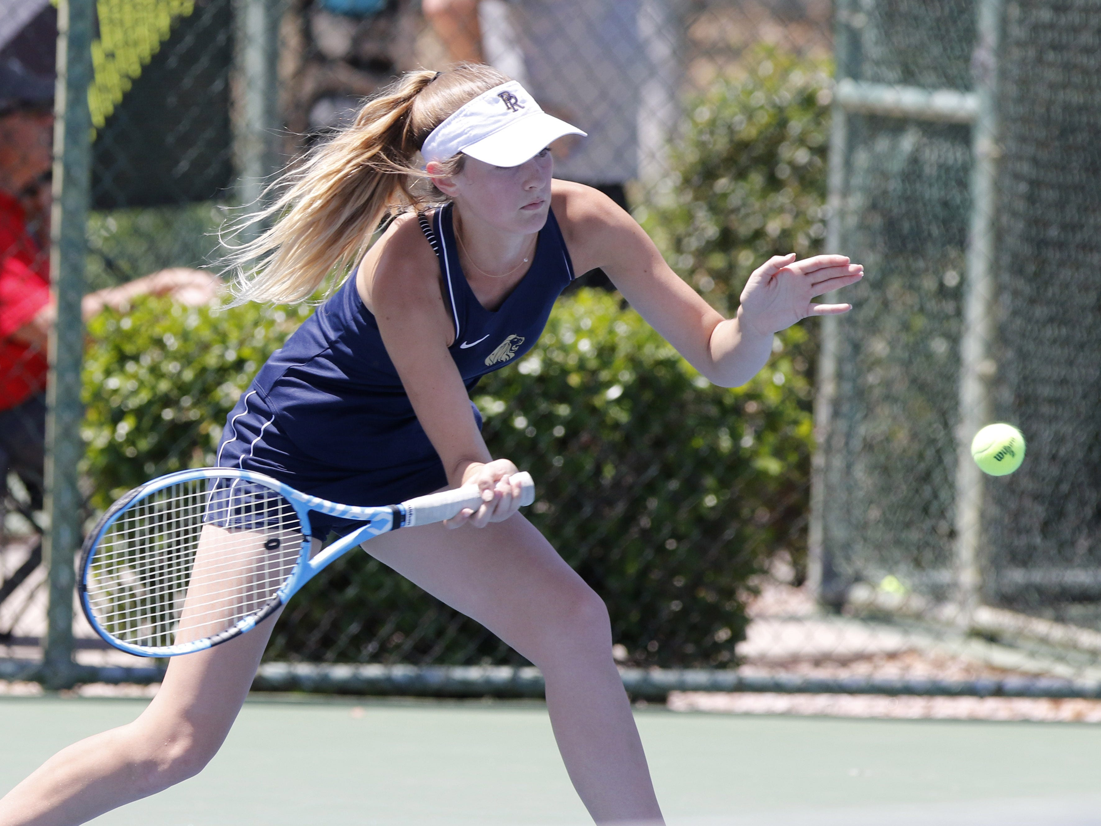 Pusch Ridge's Emma Reily returns a shot against Thatcher's Ashlyn McMasters during the Division III tennis team state championship in Glendale, Arizona, May 04, 2019.
