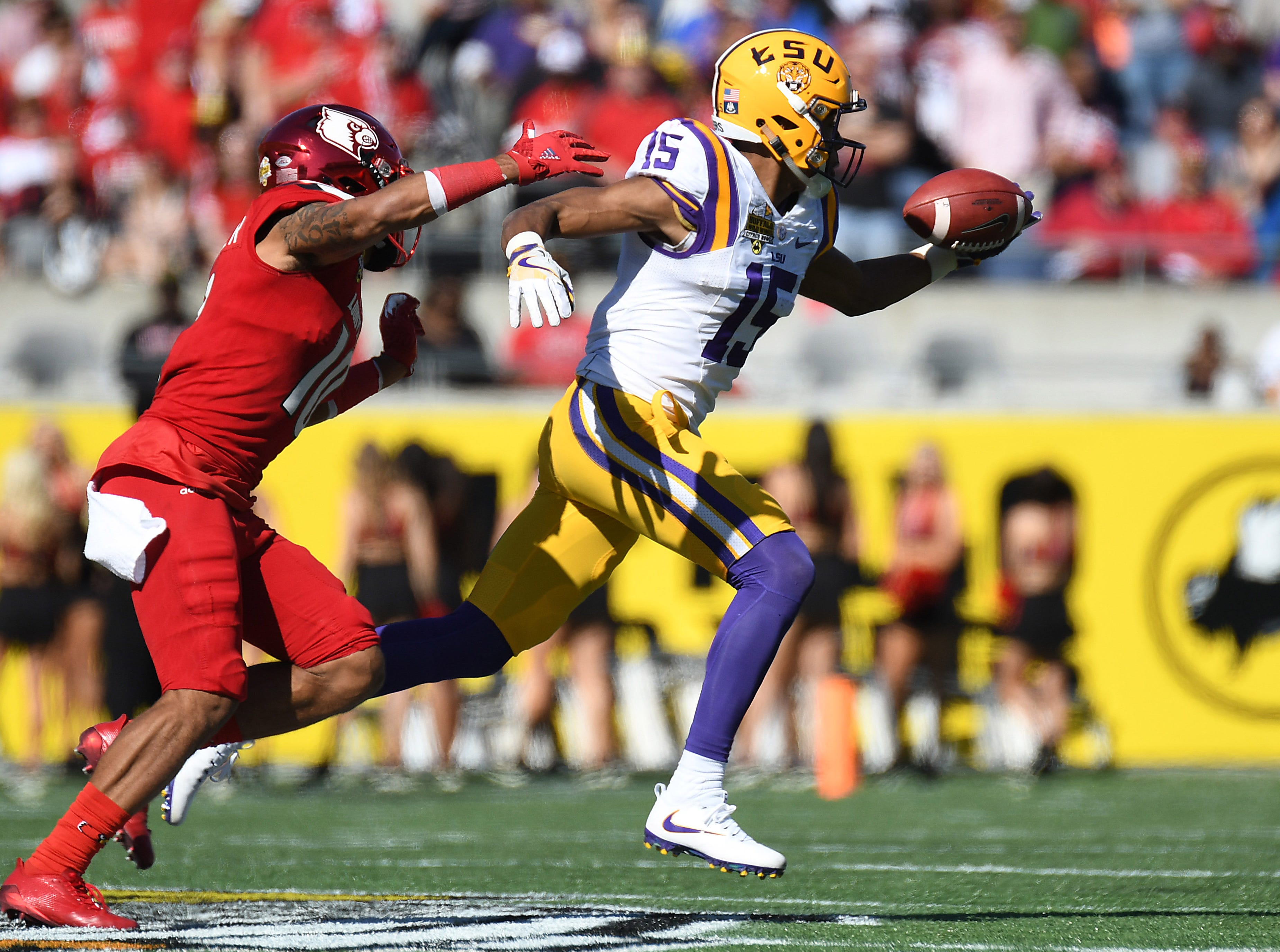 LSU receiver Malachi Dupre makes a one handed catch against Louisville during a game at Camping World Stadium.