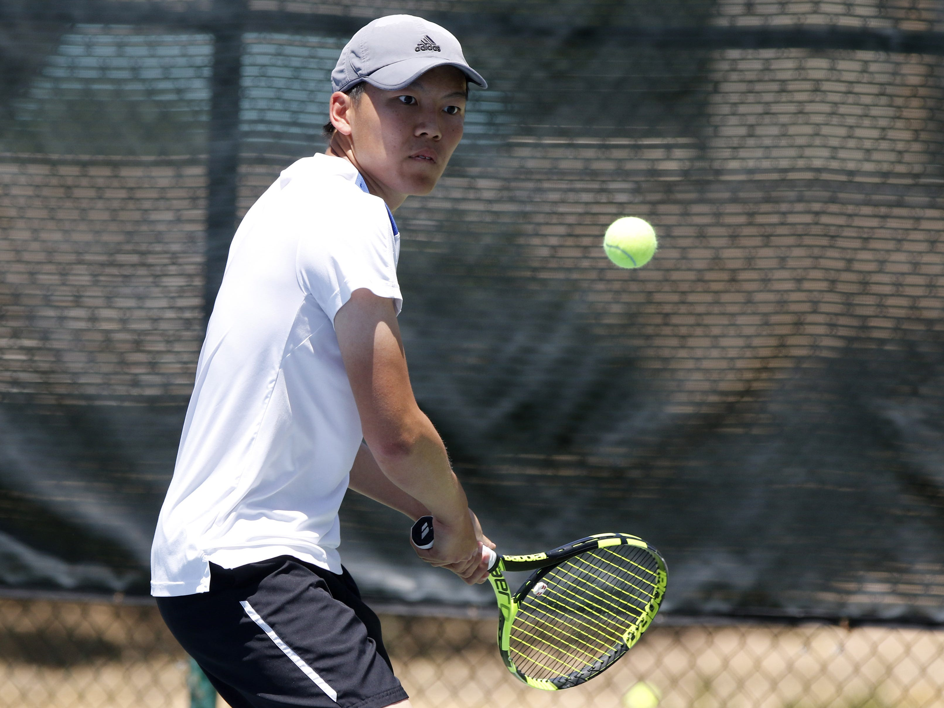 Phoenix Country Day's Alex Tam returns a shot against Scottsdale Prep's Aidan Bossone during the Division III tennis team state championship in Glendale, Arizona, May 04, 2019.