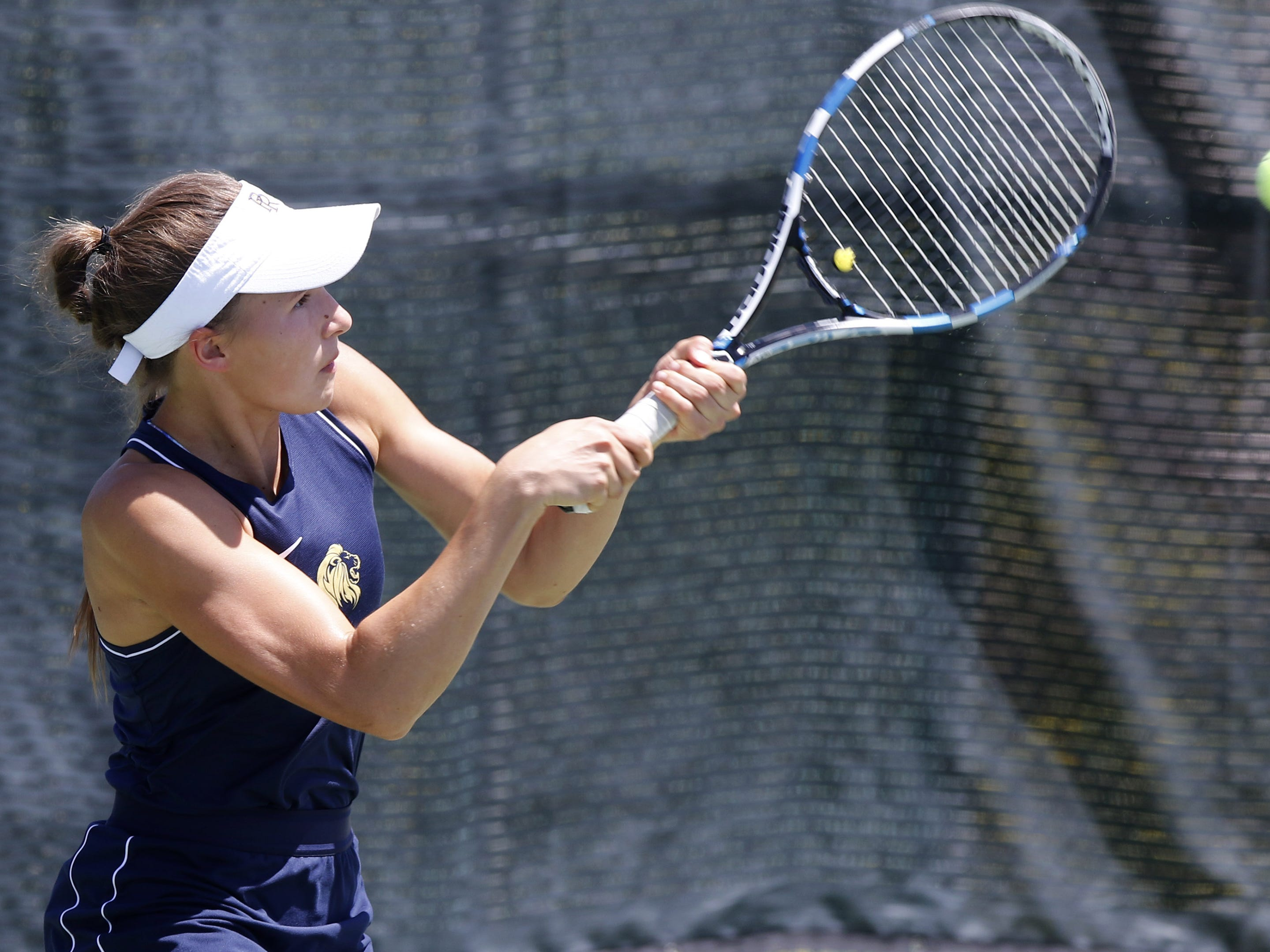 Pusch Ridge's Sofia Fetsis hits her backhand against Thatcher during the Division III tennis team state championship in Glendale, Arizona, May 04, 2019.