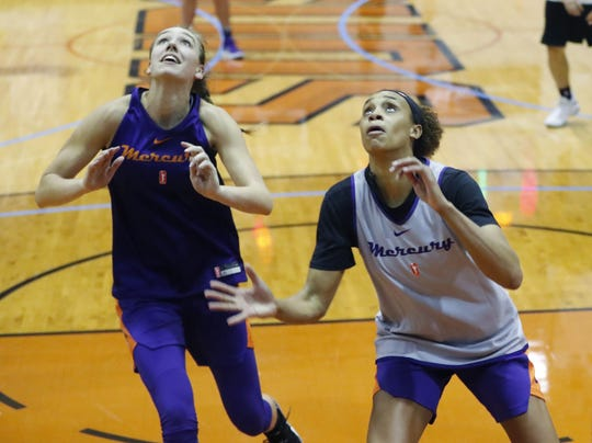 Phoenix Mercury's Alanna Smith (left) and Brianna Turner rebound during training camp in Phoenix May 5, 2019.