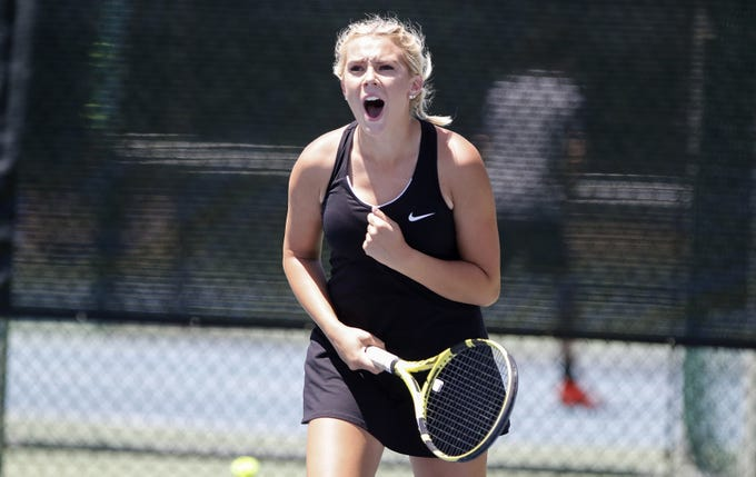 Thatcher's Lexee Scarborough celebrates a shot as she plays doubles with Savanna Turley during the Division III tennis team state championship in Glendale, Arizona, May 04, 2019.