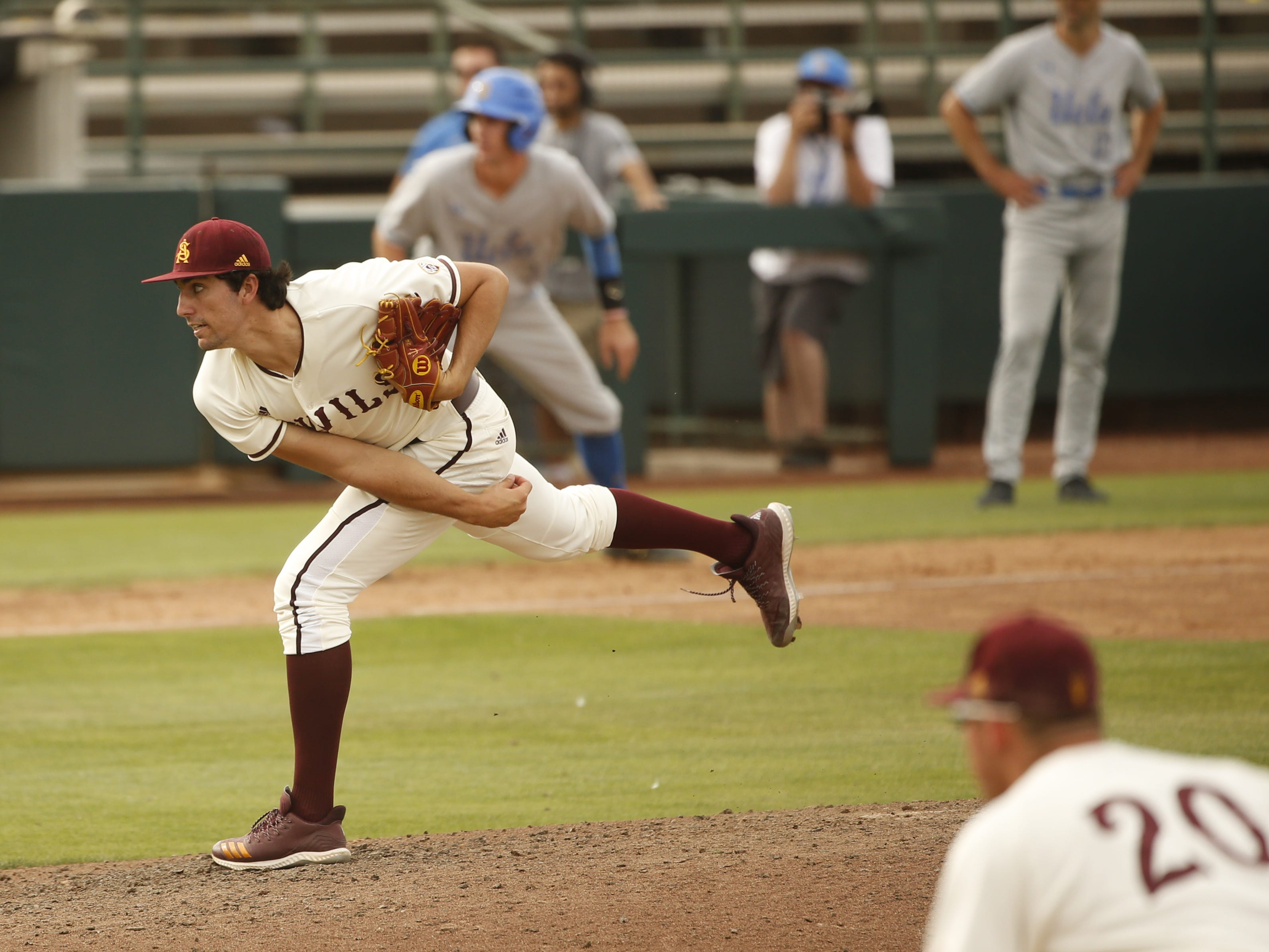 ASU's Blake Burzell (24) pitches in relief against UCLA during the seventh inning at Phoenix Municipal Stadium in Phoenix, Ariz. on May 5, 2019.