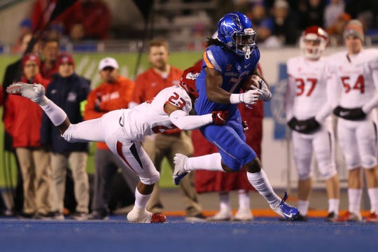 Boise State receiver A.J. Richardson runs with the ball during a game against Fresno State at Albertsons Stadium.