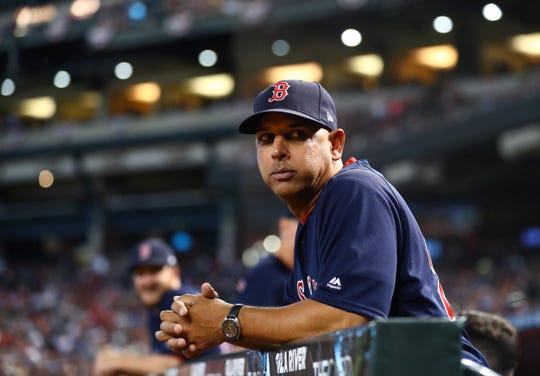 Red Sox manager Alex Cora looks on during a game against the Diamondbacks at Chase Field.