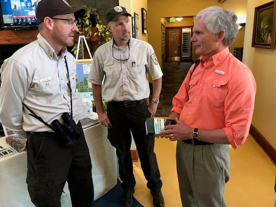 U.S. Rep. Bob Latta, R-Bowling Green, speaks with Ottawa National Wildlife Refuge Manager Jason Lewis, pictured left, and Assistant Manager Eddy Pausch Monday as part of a visit to the refuge during the Biggest Week in American Birding.