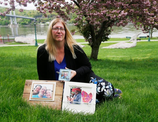 Genevieve Bodgan sits with family photos at Waryas Park in the City of Poughkeepsie on May 6, 2019. Bodgan's mother, Rita passed away in 2016, and Genevieve has found several ways to cope with the loss, especially around Mothers Day.