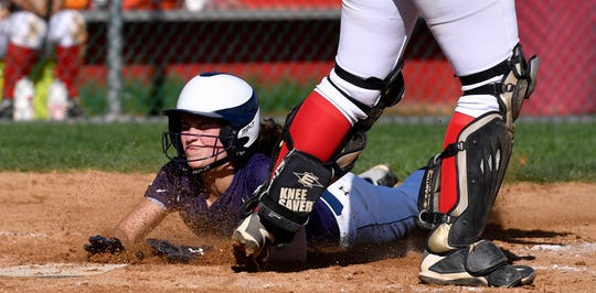 Eastern York's Morgan Dobbeck slides safely into the plate on a hit by Maelynn Leber, Monday, May 6, 2019.