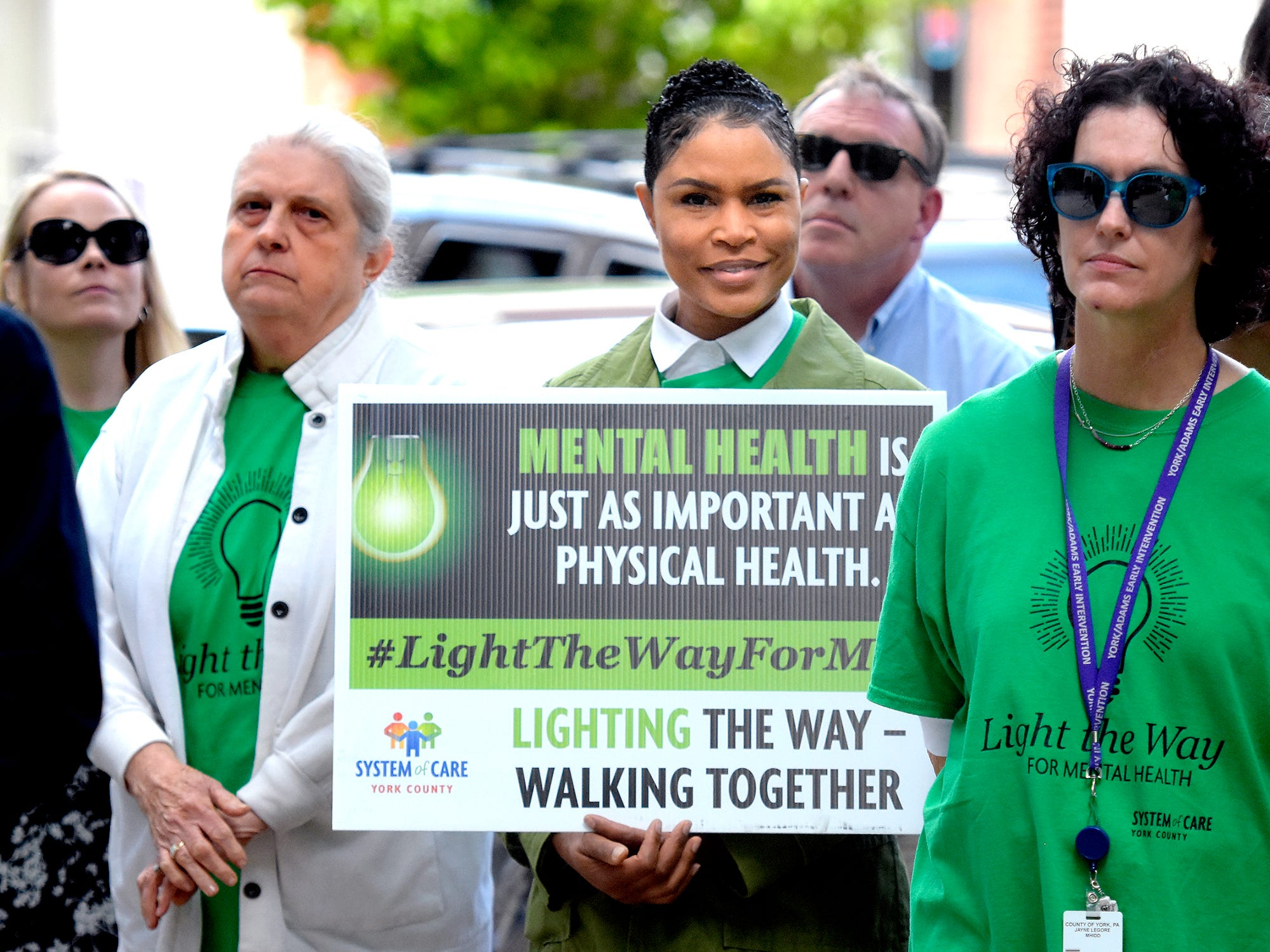 Supporters gather outside the York County Human Services building before the Walk To Raise Awareness About Mental Health in York City Monday, May 6, 2019. The York County System of Care in collaboration with York County Human Services sponsored the walk during Mental Health Awareness Month. Area business and organizations will be displaying green lighting through May 12th to show support. Bill Kalina photo