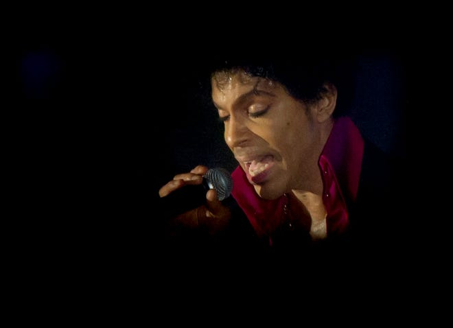 Prince performs at the SXSW Music Festival in Austin, Texas, in 2013.  (Jay Janner/Austin American-Statesman/TNS)