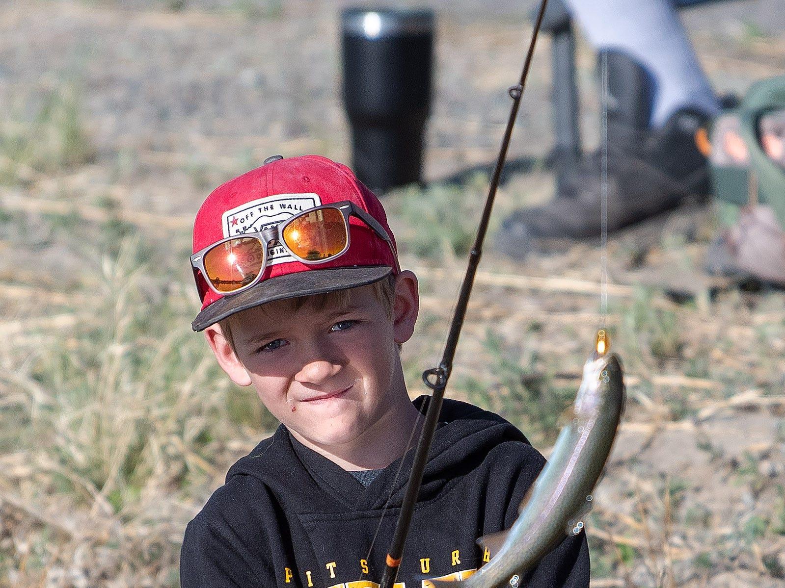 Jare Huntley, 9, reels in his catch.
