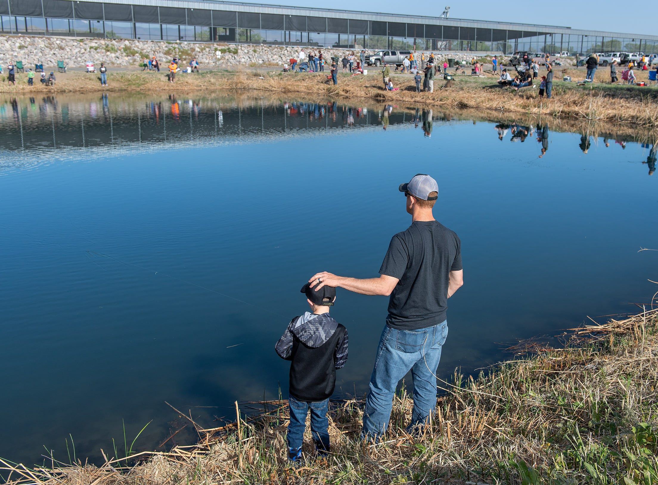 Colton Borsini, 5, and his dad Jason Borsini, from Yerington, fish the holding pond.
