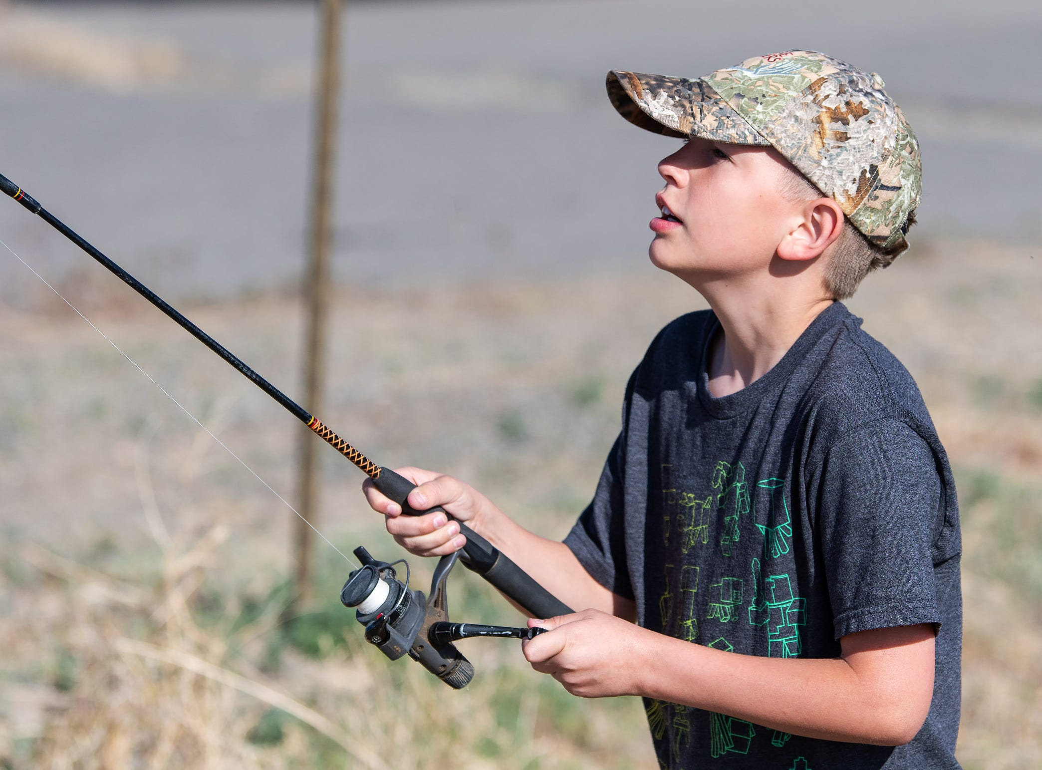 Justice Hanson, 10, from Yerington, reels in his line.