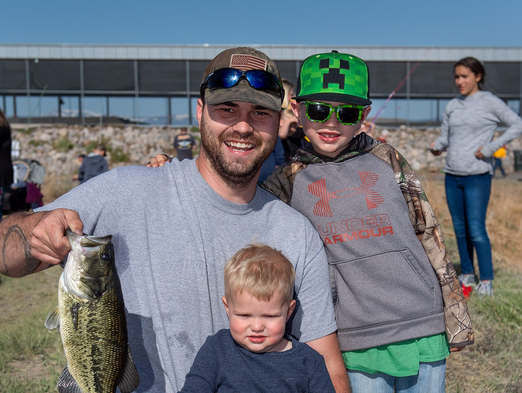 Connor Dwyer, 3, Colton Inserra, 7, and Edward Dwyer, from Yerington, show off their catch.