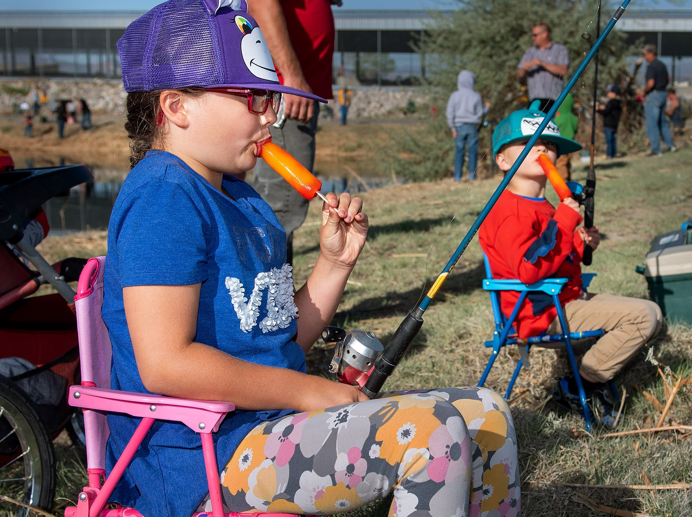 Adelyn Boger, 8, and her brother Caleb Boger, 4, from Yerington, enjoy popsicles while fishing.