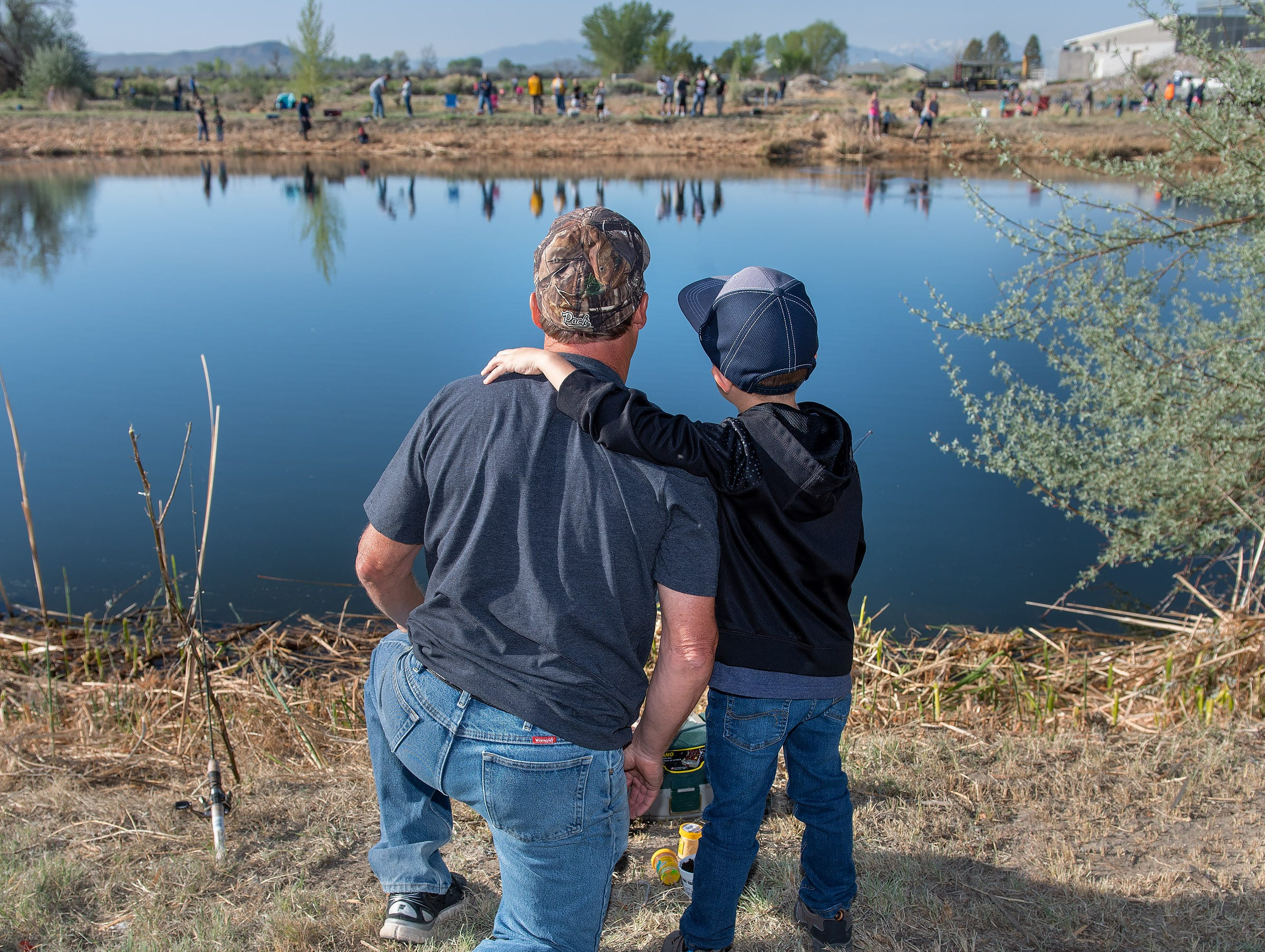 A father and son enjoy the fishing.
