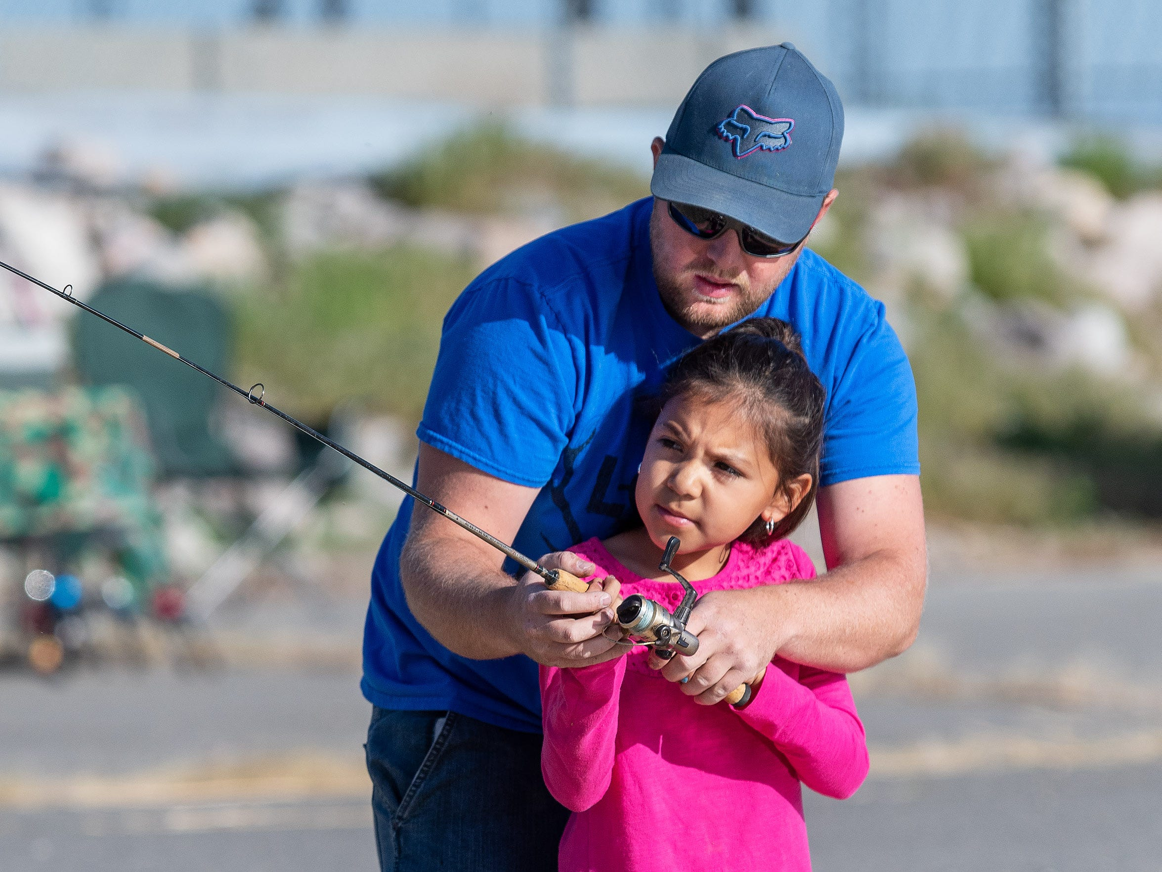 Emeilia Guerrero, 9, from Yerington, gets help casting from her stepdad Bryce Chisum.