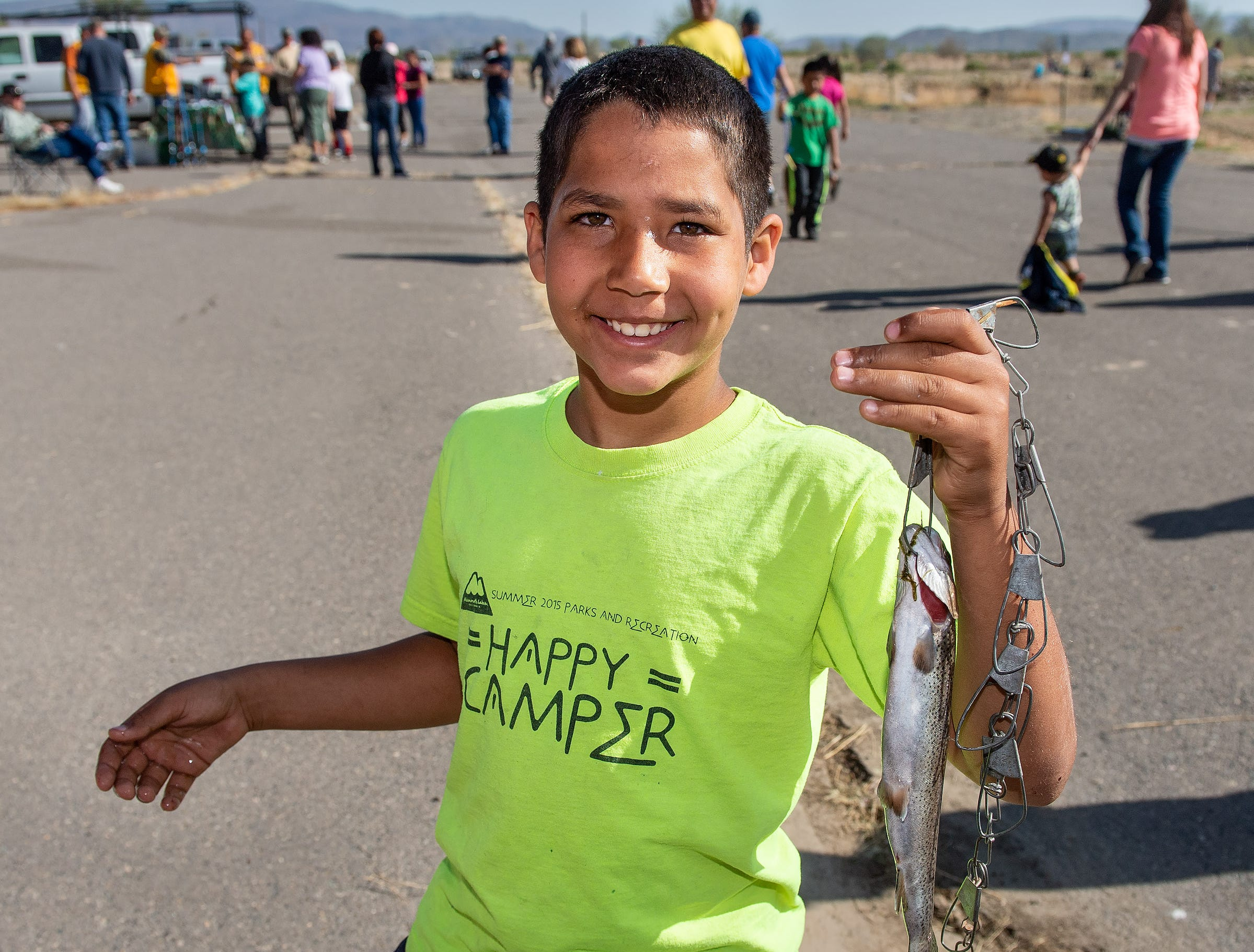 Michael Kettlaar, 8, from Yerington, shows off his Rainbow Trout.