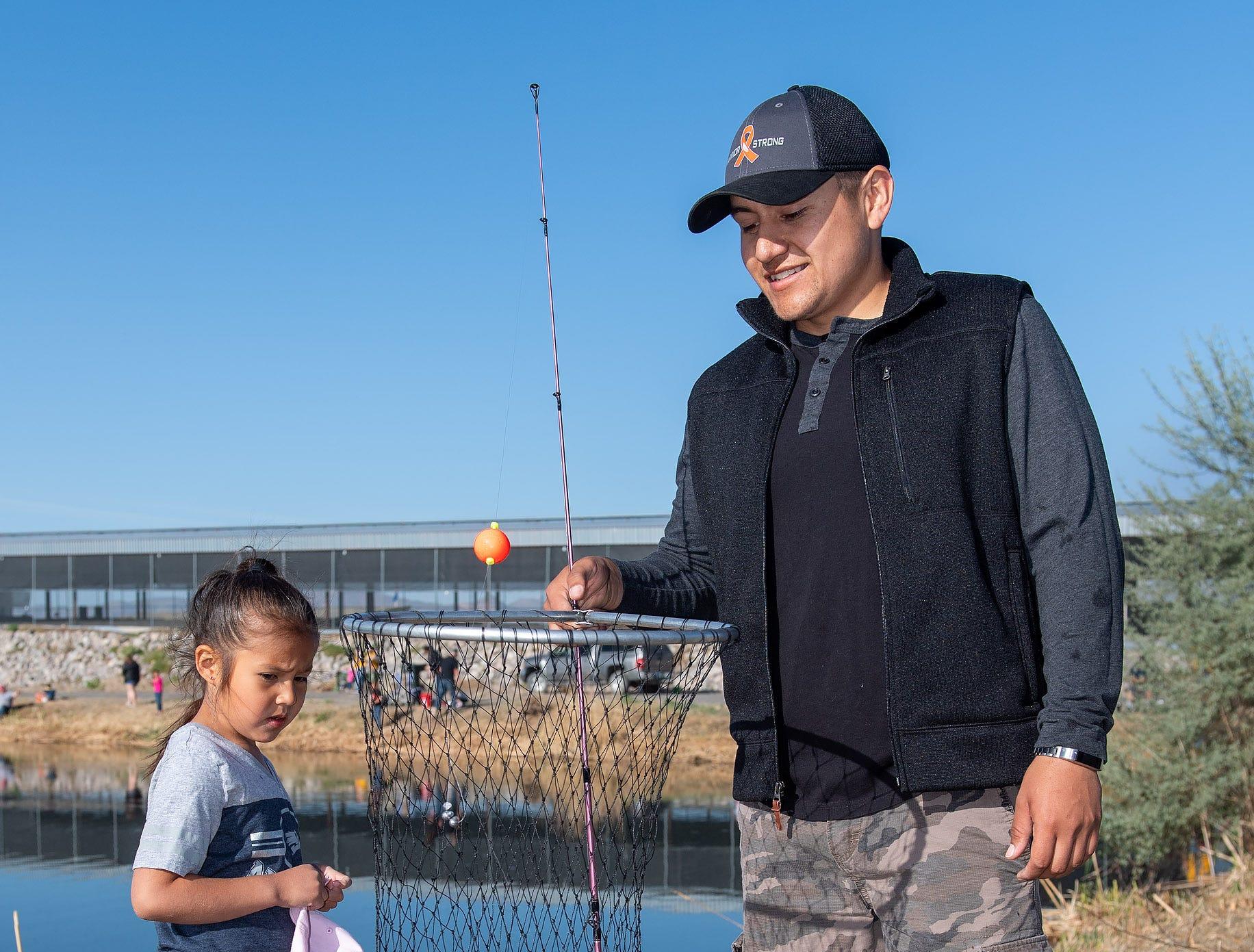 Emma Meza, 5, from Yerington, and her Dad Julian Meza, from Yerington, admire her catch.