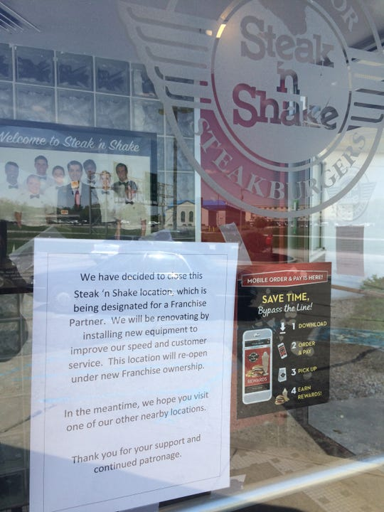A notice on the front door Monday explains the temporary closure of Richmond's Steak 'n Shake at 5901 National Road E.